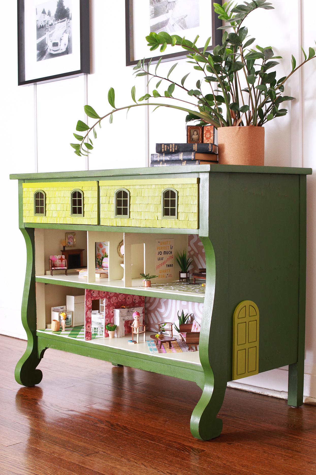 green dresser with dollhouse inside