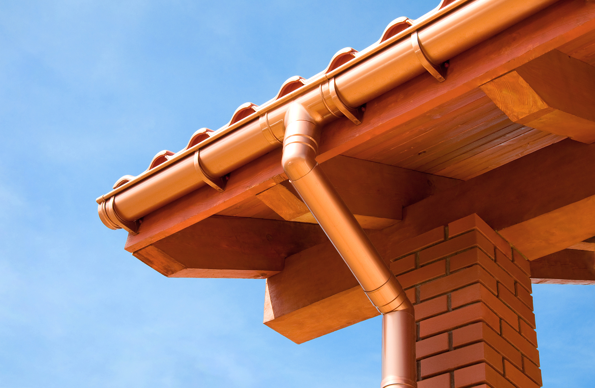 downspout and gutter on orange house