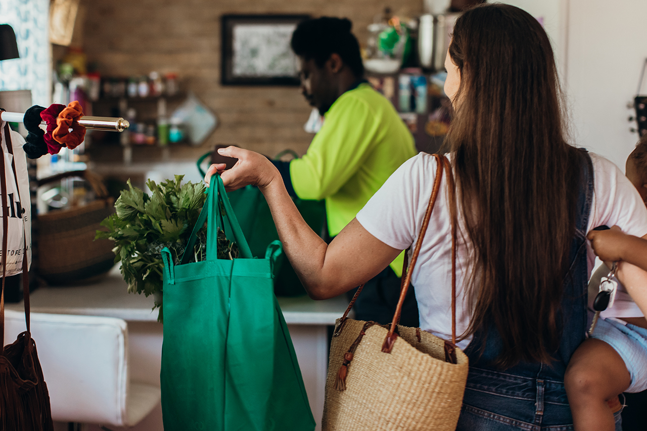 woman grocery shopping reusable bags