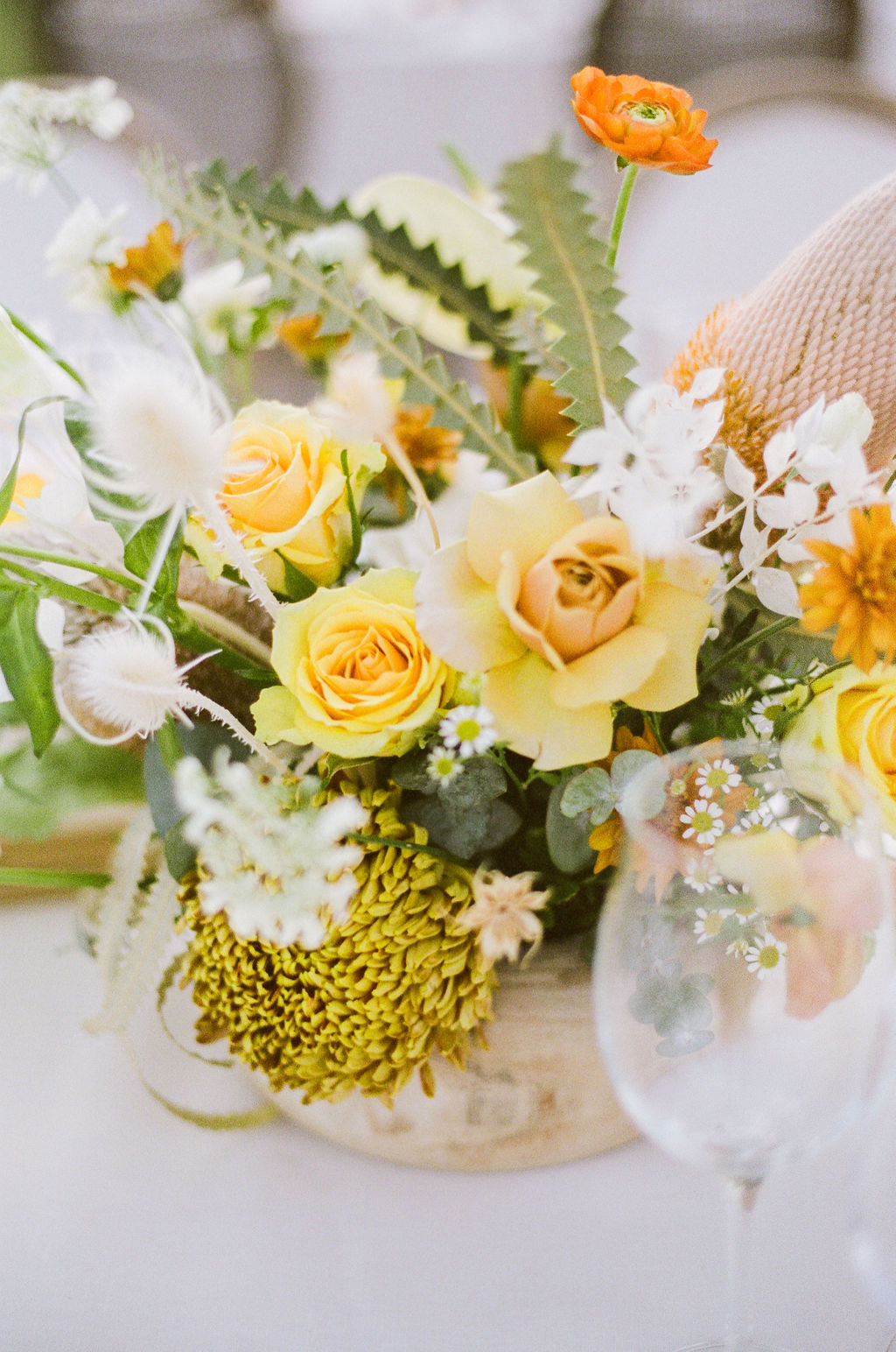 citrus colored floral bouquets at wedding reception