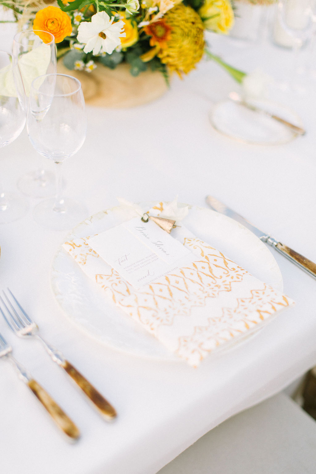 white and yellow wedding reception place setting