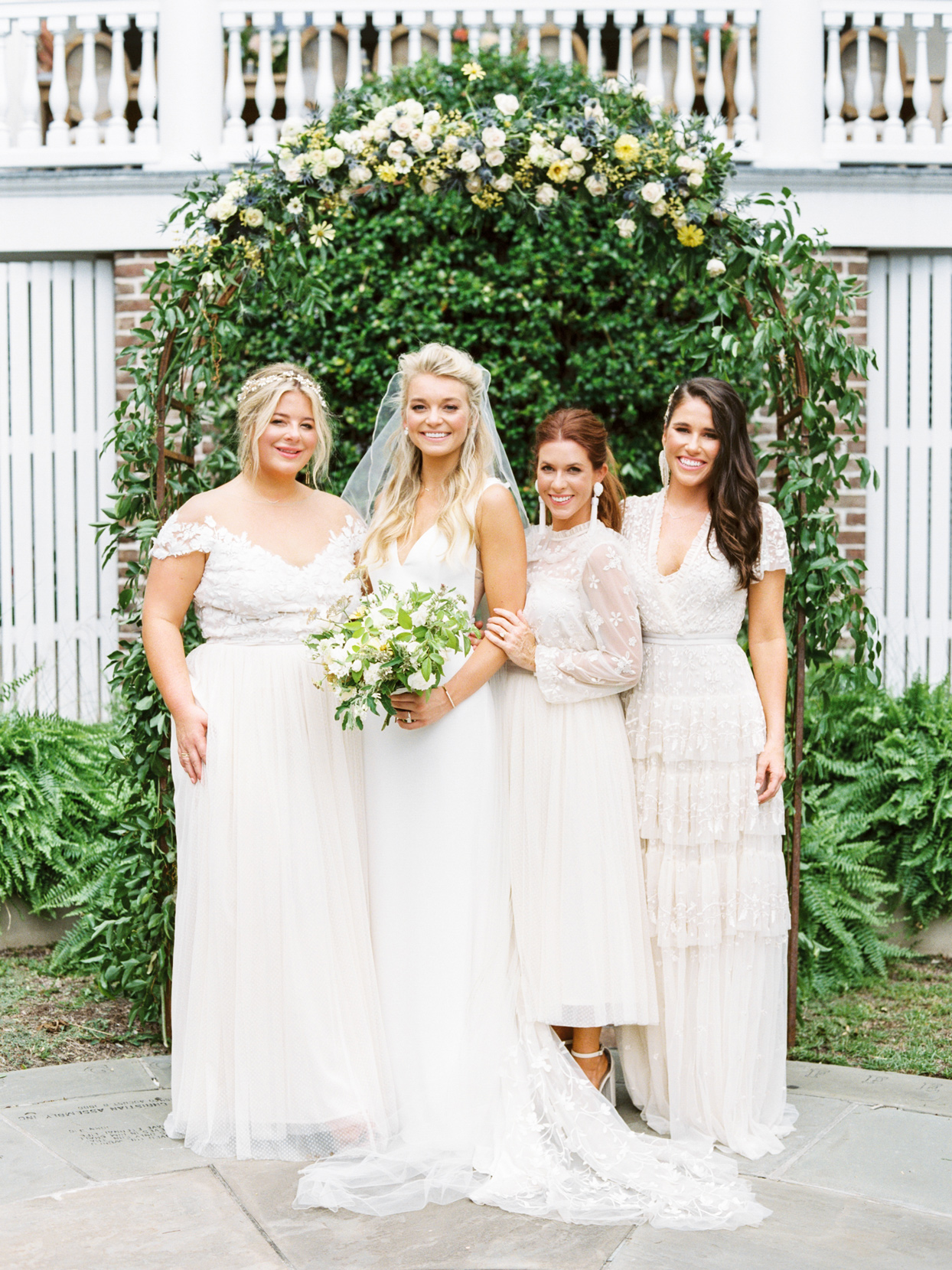 bride with bridesmaids wearing white dresses