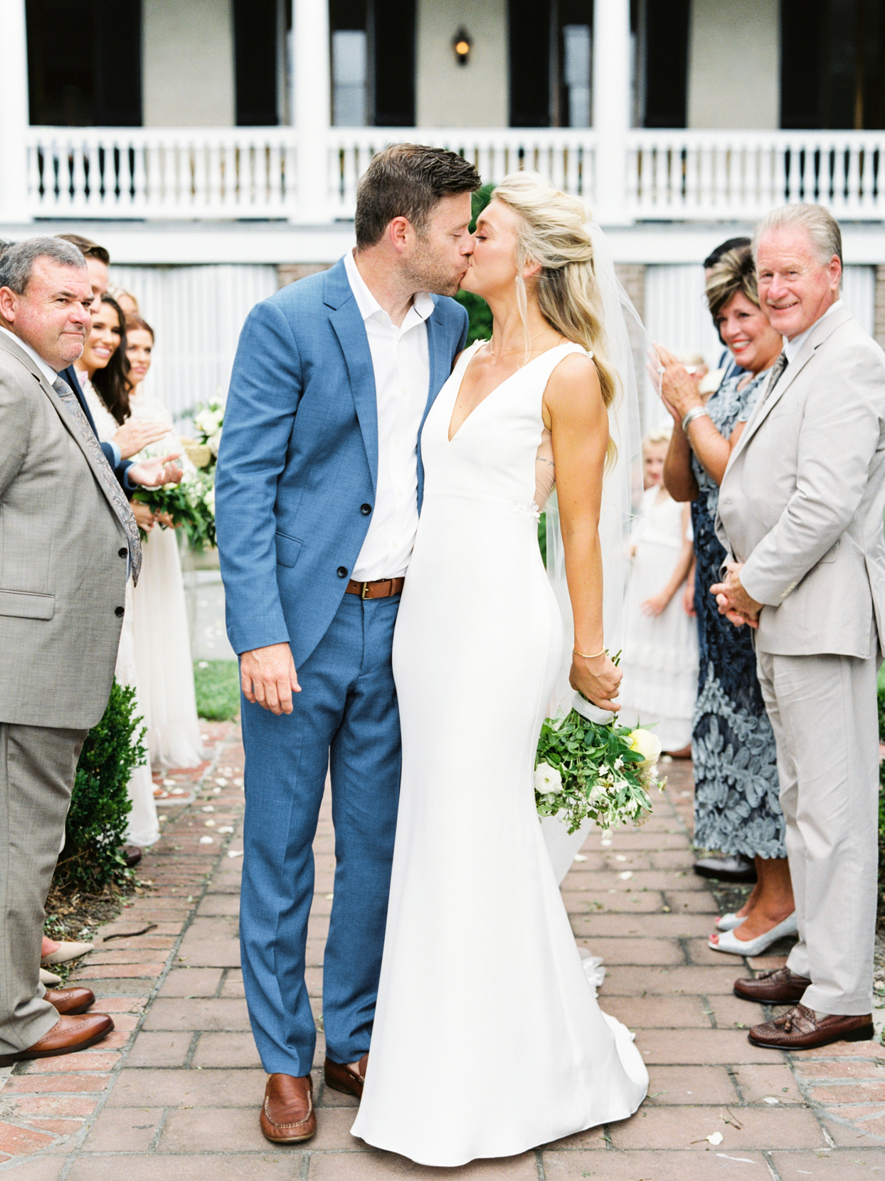 bride and groom share a kiss on the recessional aisle