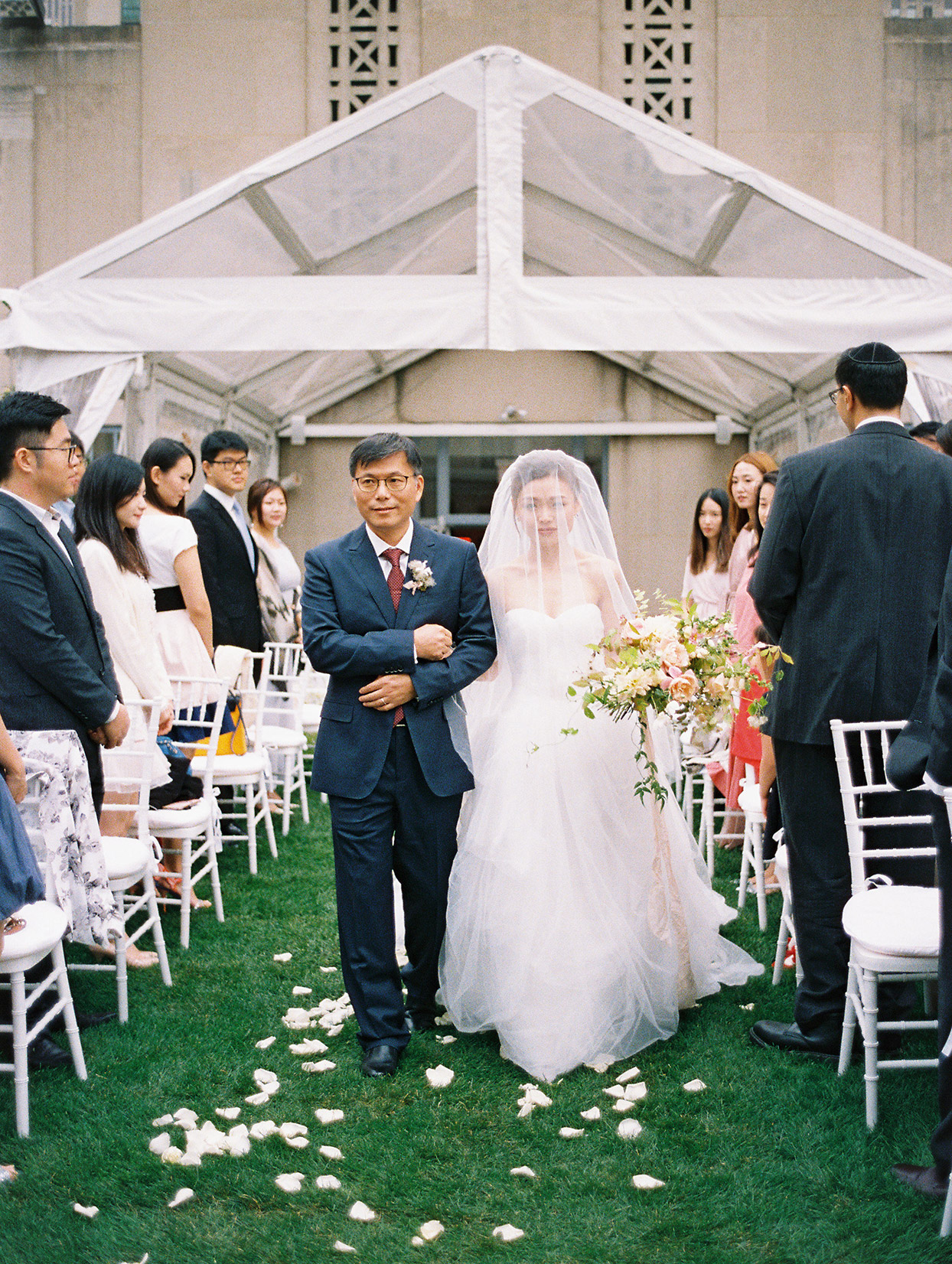 bride and father processing down aisle at wedding