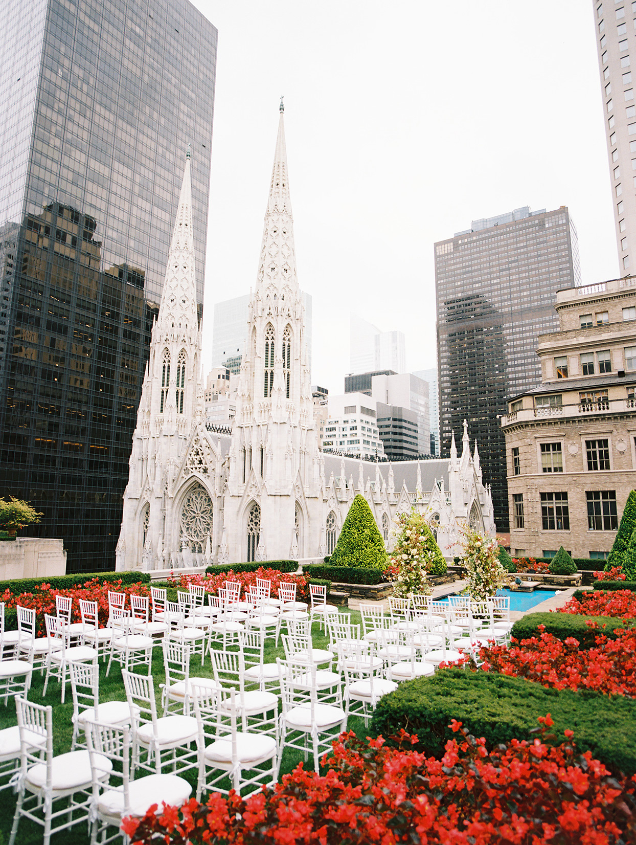 wedding ceremony white chairs on grassy rooftop in nyc