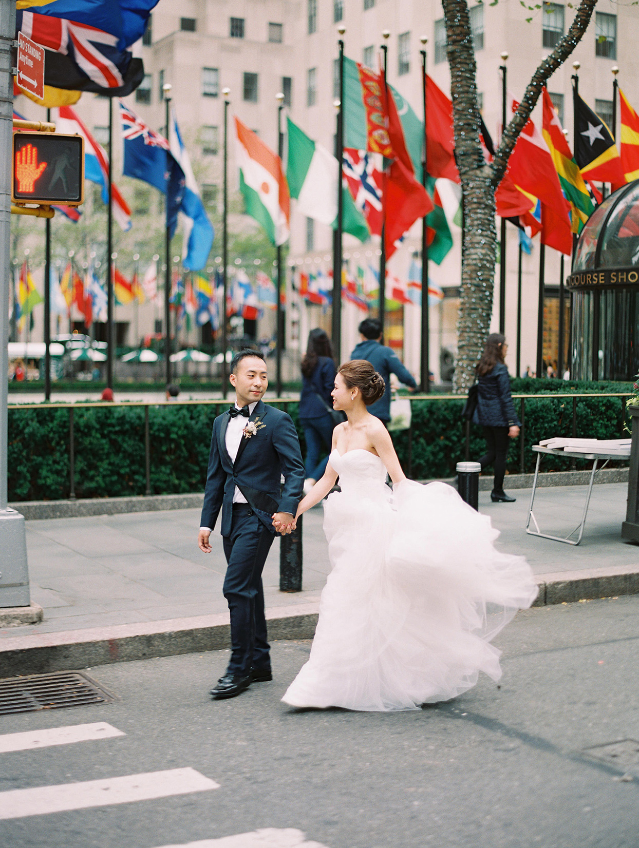 couple walking through nyc holding hands