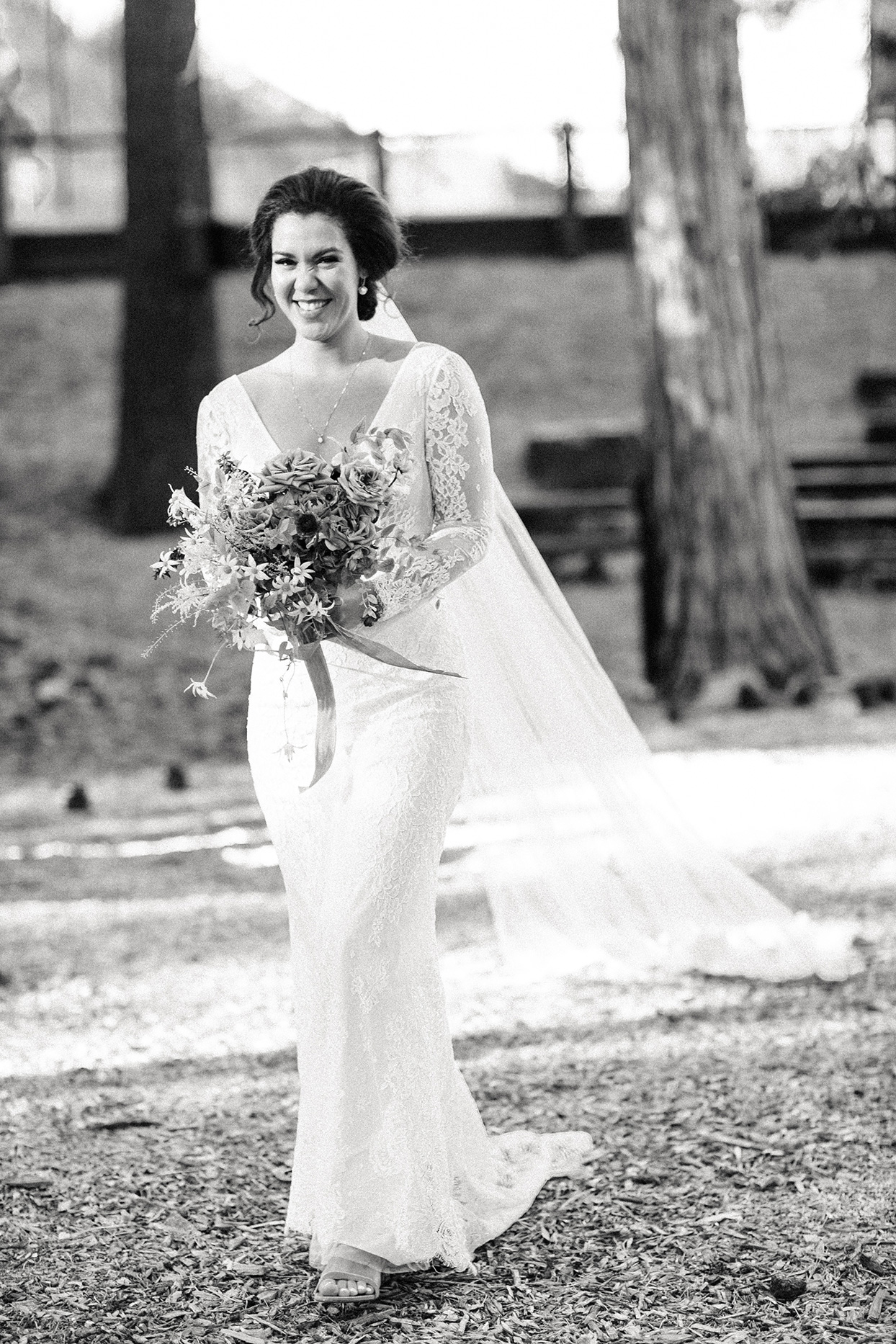 bride smiling while she walks down the aisle for wedding ceremony