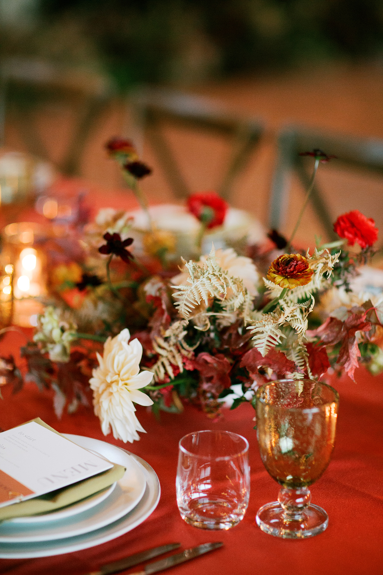 elegant fall wedding table setting with red table cloth