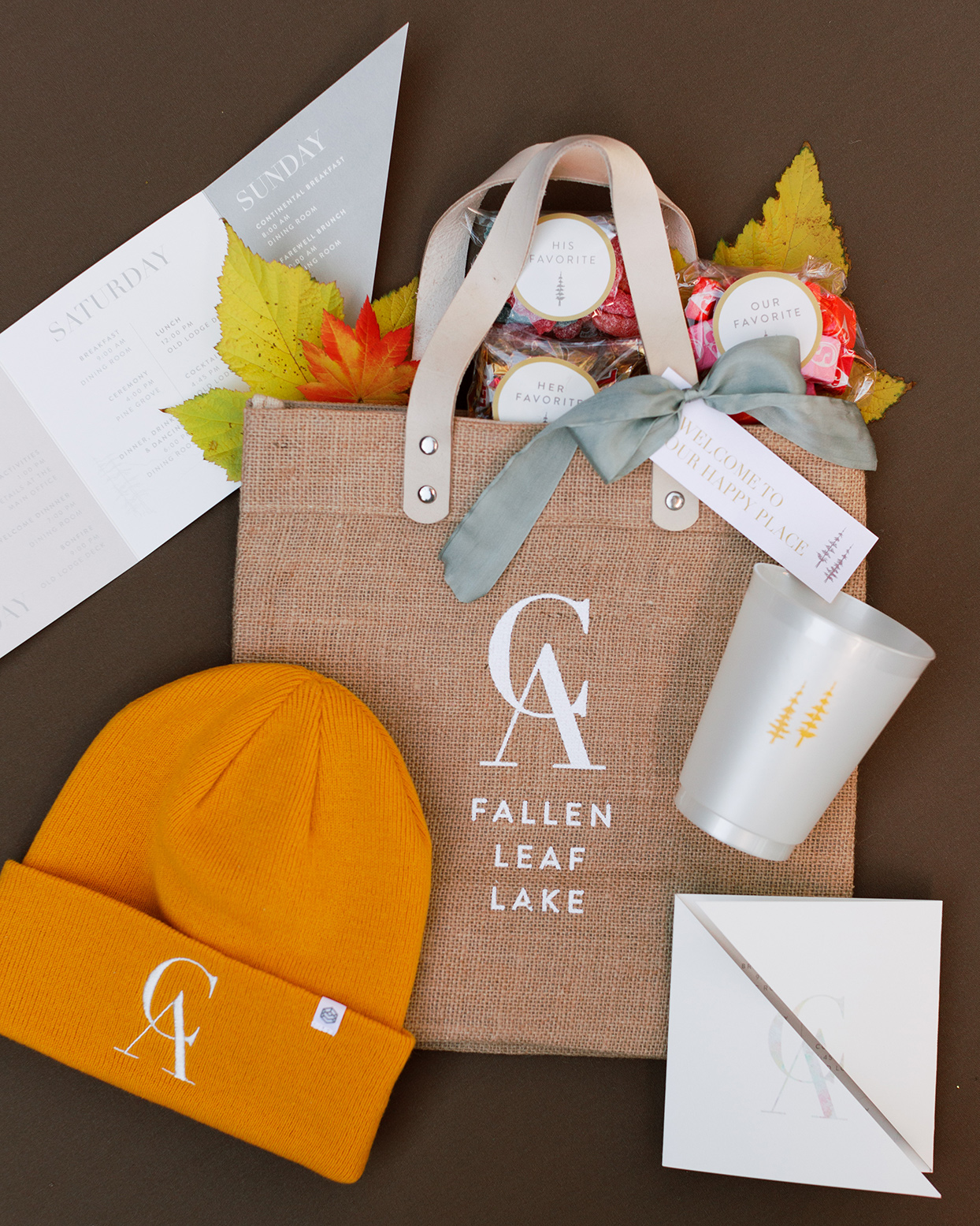 rustic welcome bags with candy, hat, cup and fall decor