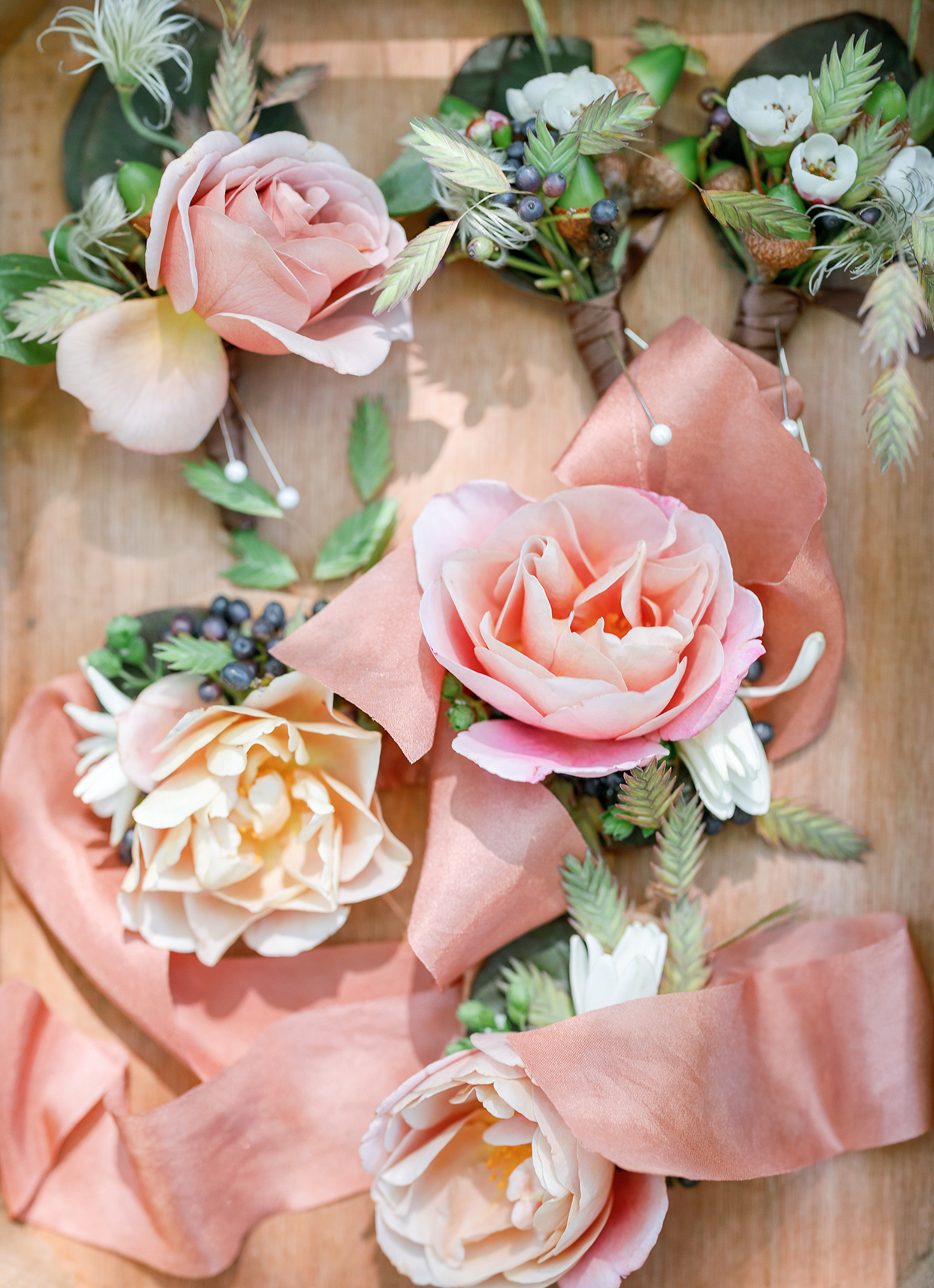 peach and coral wedding boutonnieres