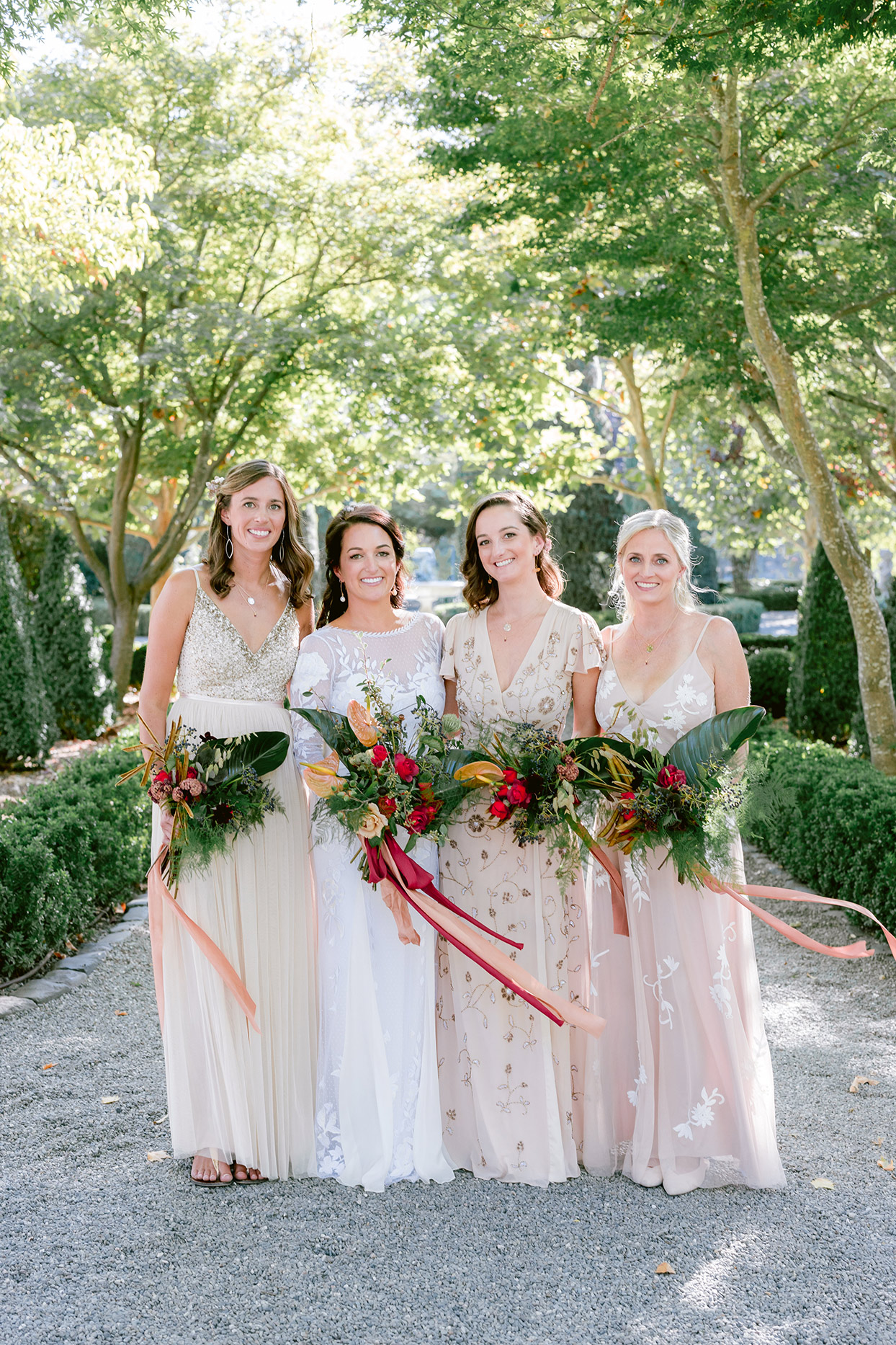 bridesmaids in light pink and neutral dresses