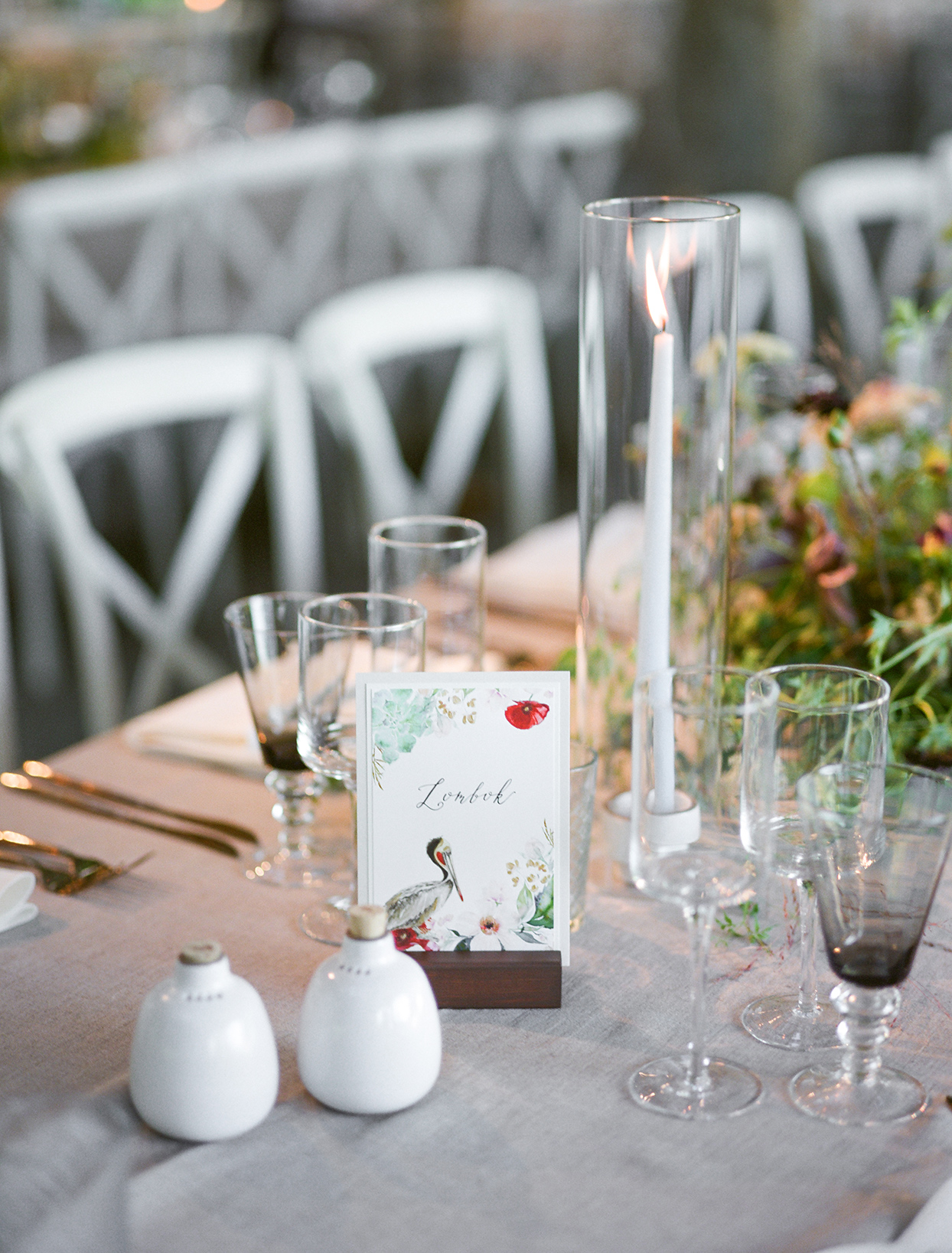 wedding reception table setting with bird themed table number