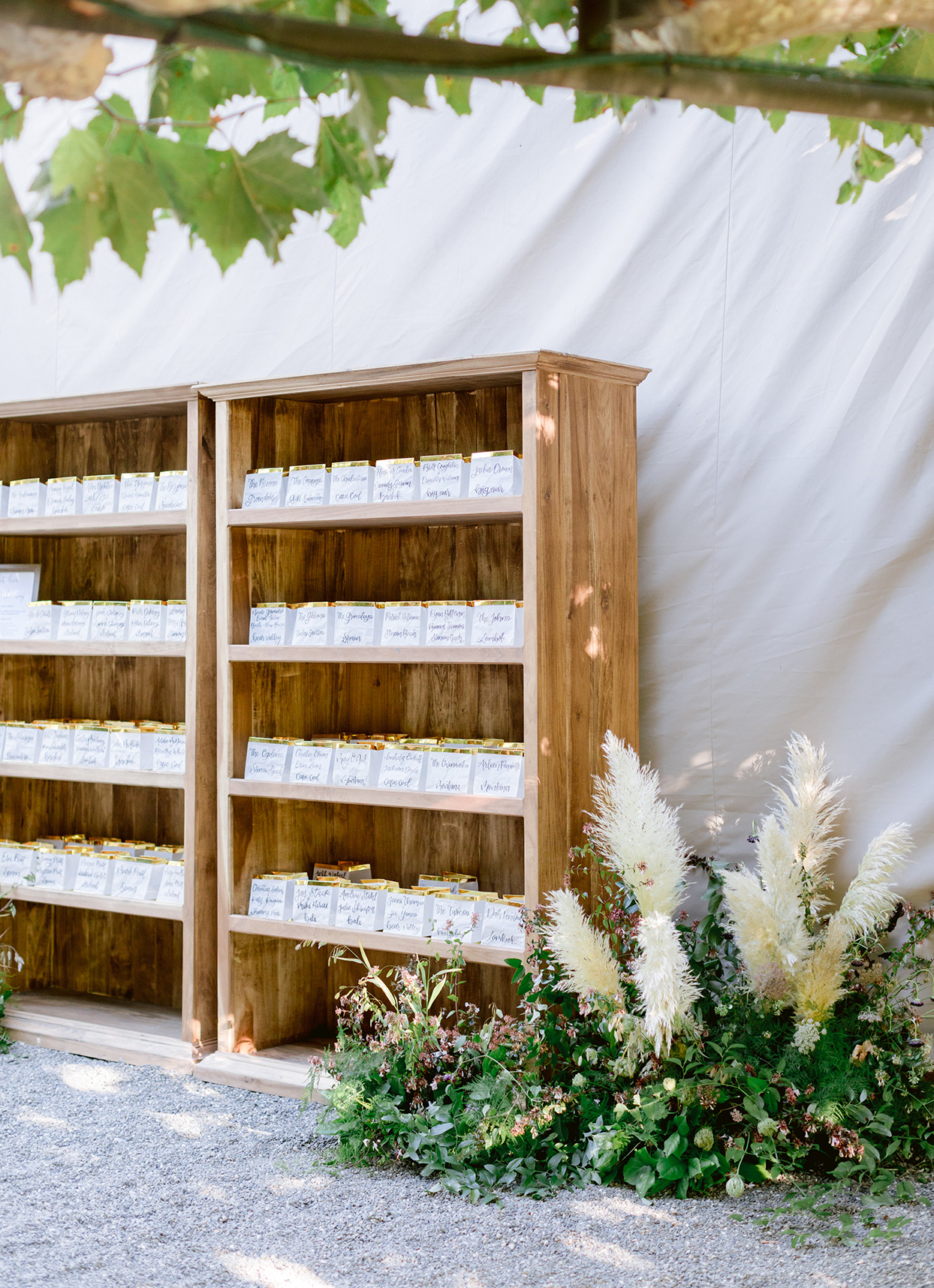 travel inspired seating chart with wooden shelves
