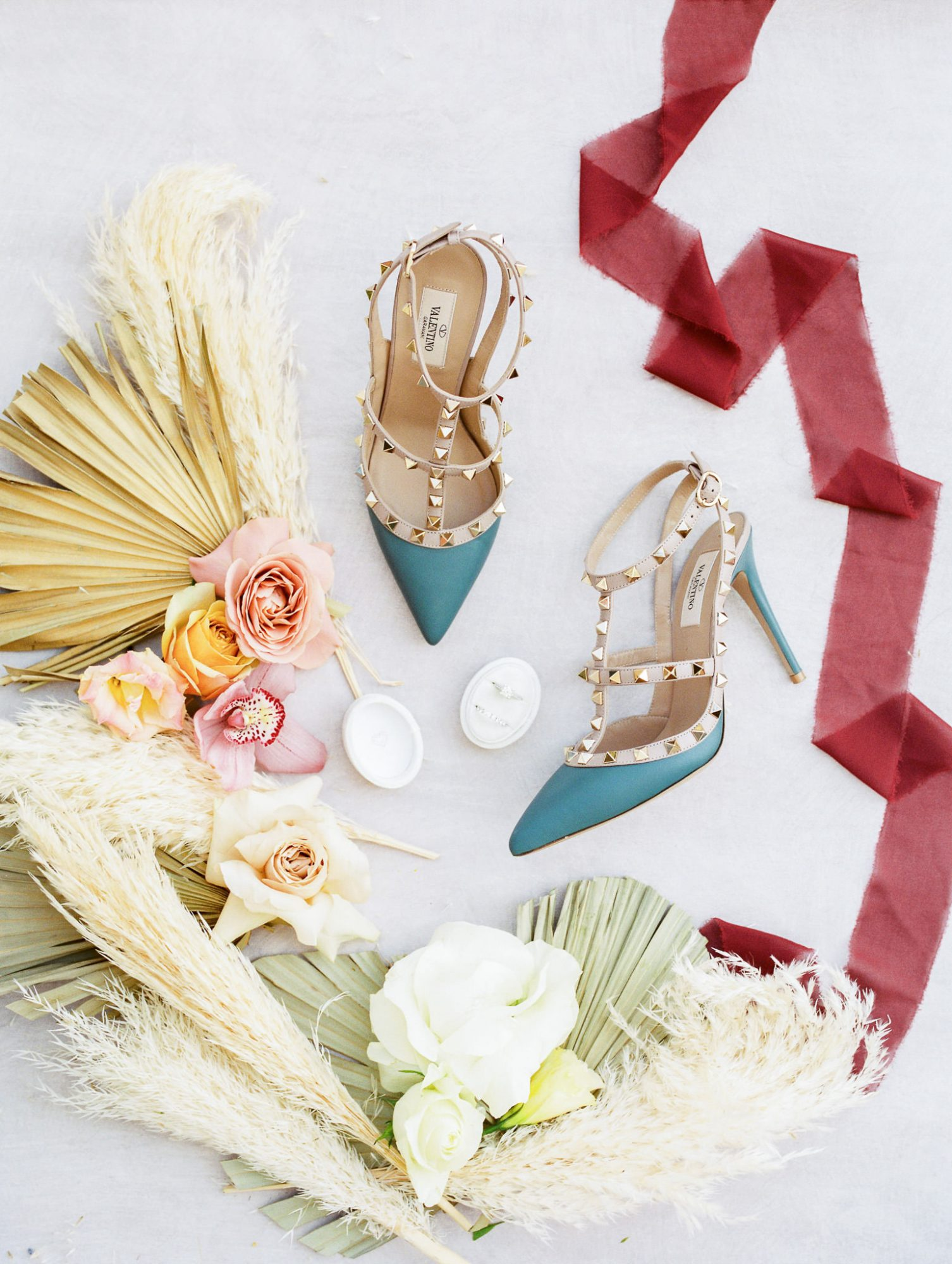 bride's blue wedding shoes with gold stud accents