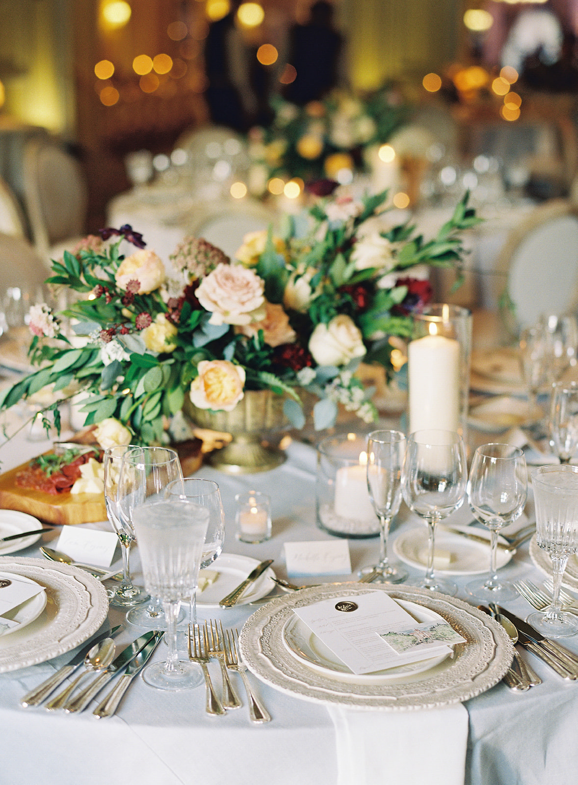 close-up of place settings and floral centerpieces