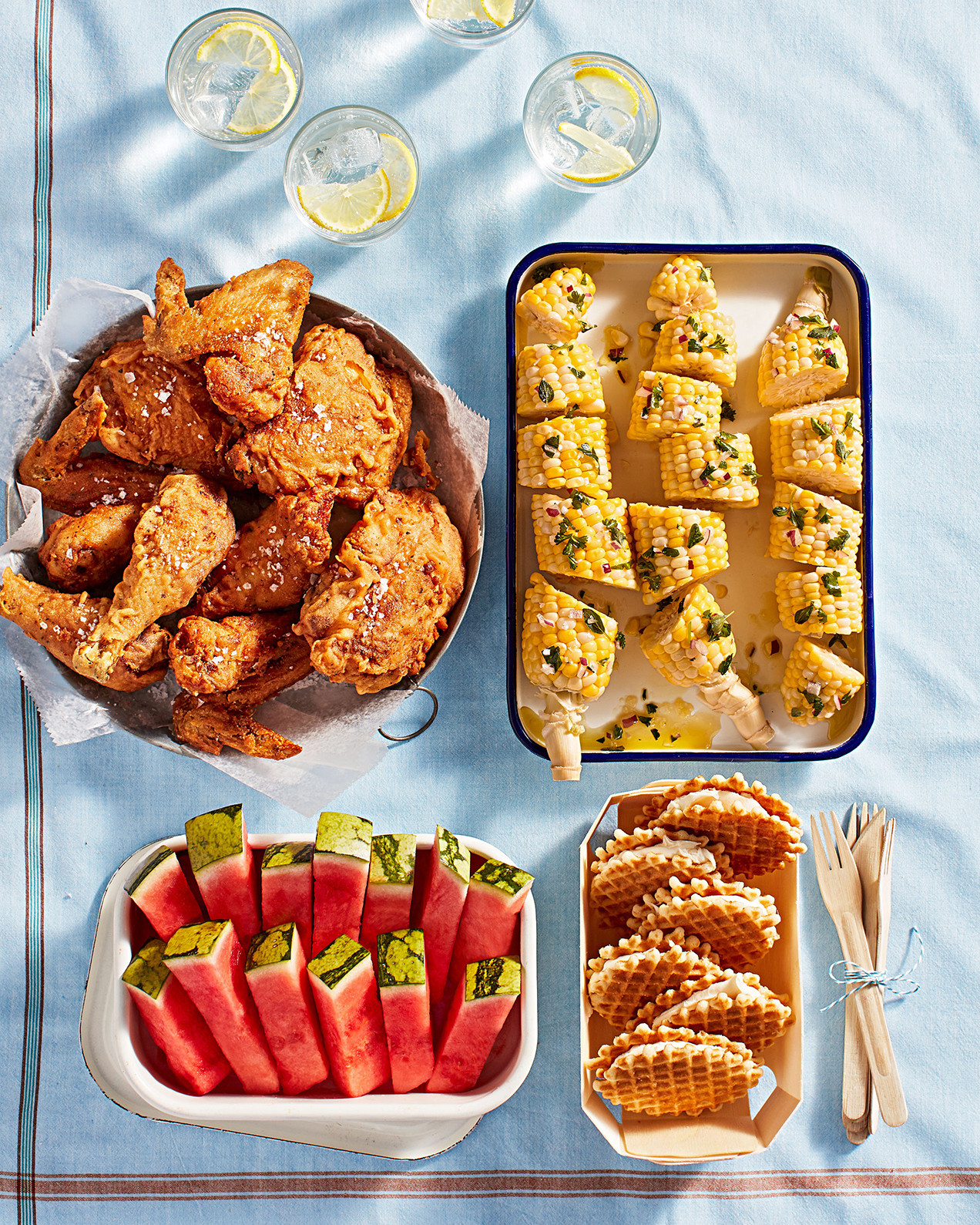 picnic spread with fried chicken, corn, watermelon, and mascarpone butter cookie sandwiches