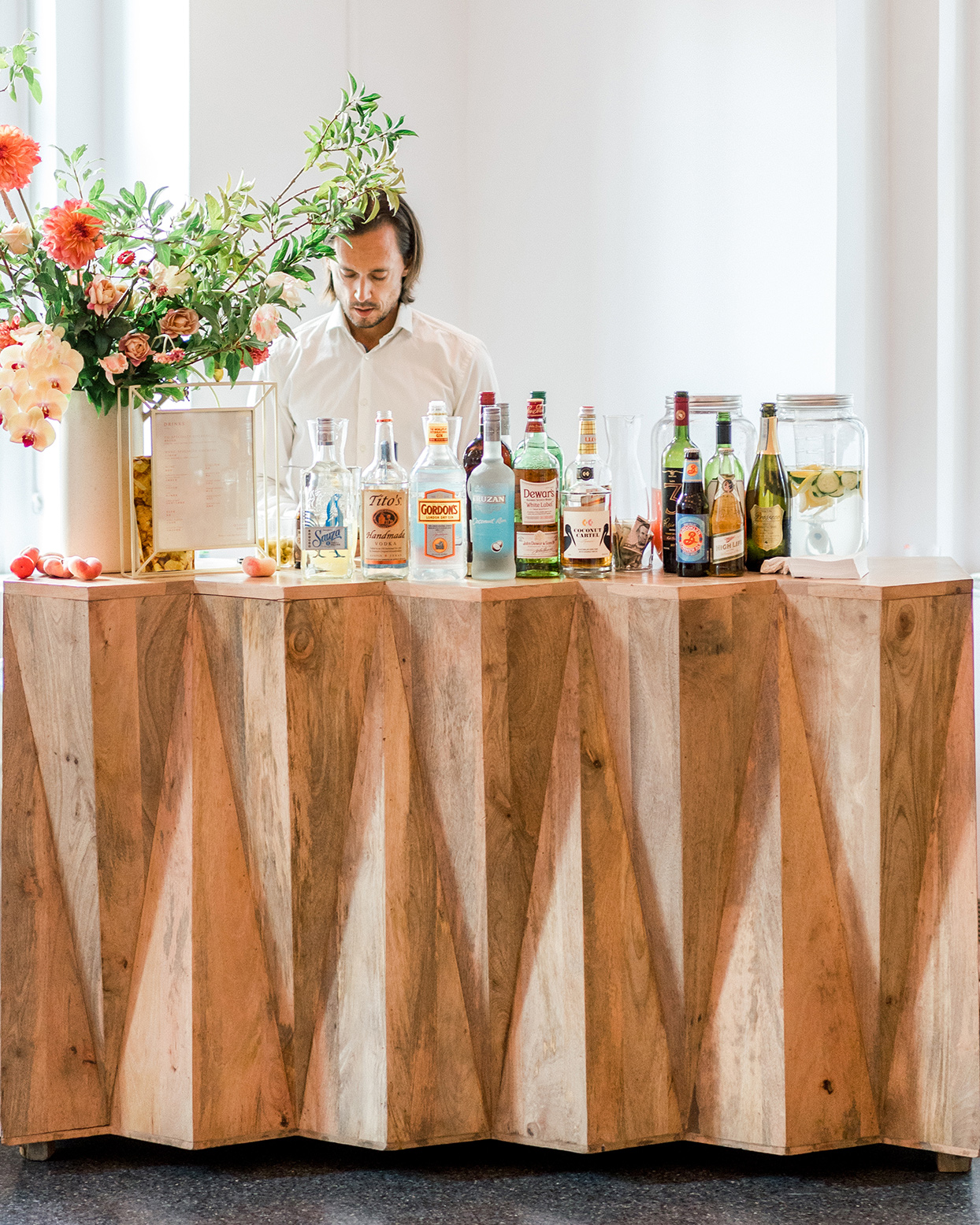 wooden geometric wedding bar with flowers and tender