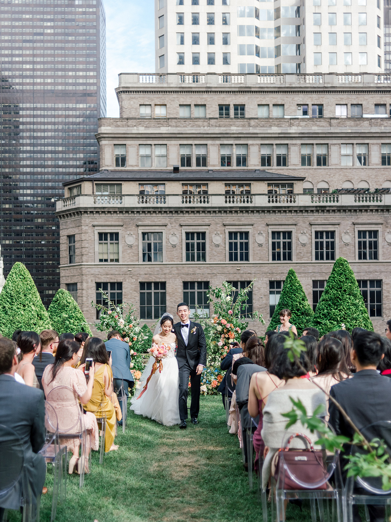 couple walking down aisle at rooftop garden ceremony