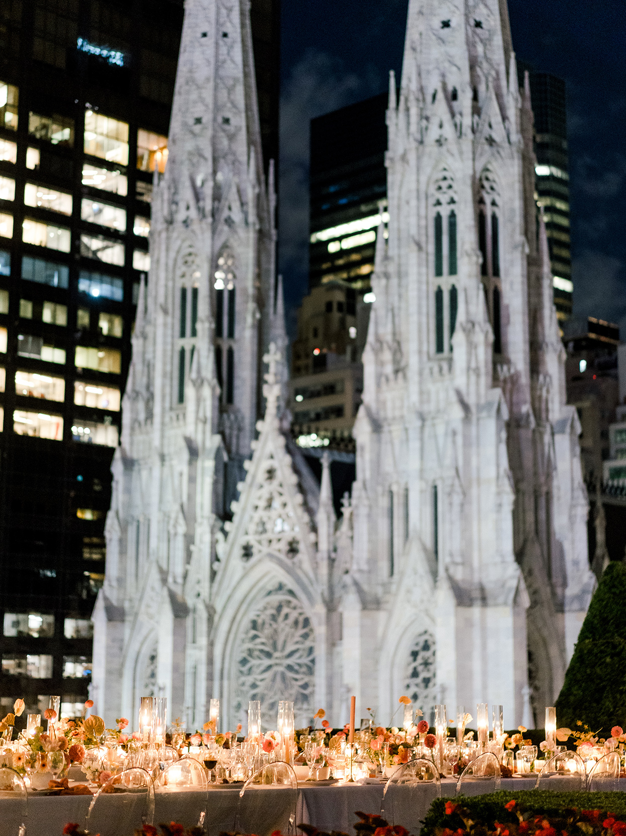 long table lit up for nighttime reception dinner on manhattan rooftop