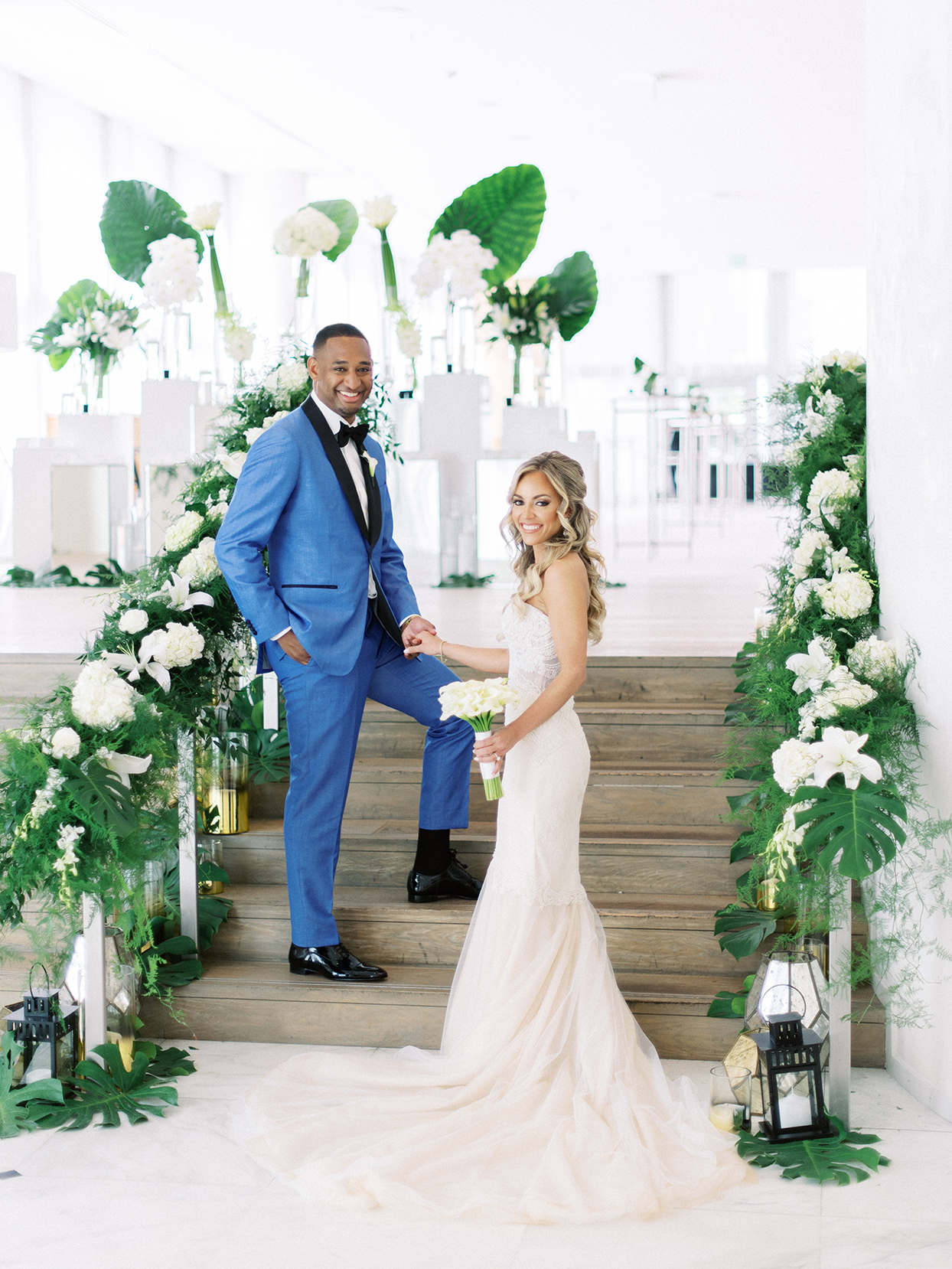 Bride and groom holding hands on stairs