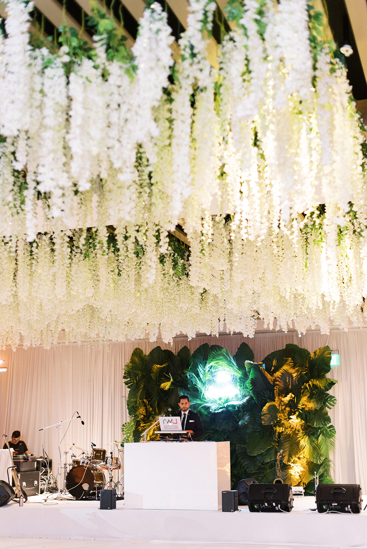 wisteria hanging over the dance floor at reception