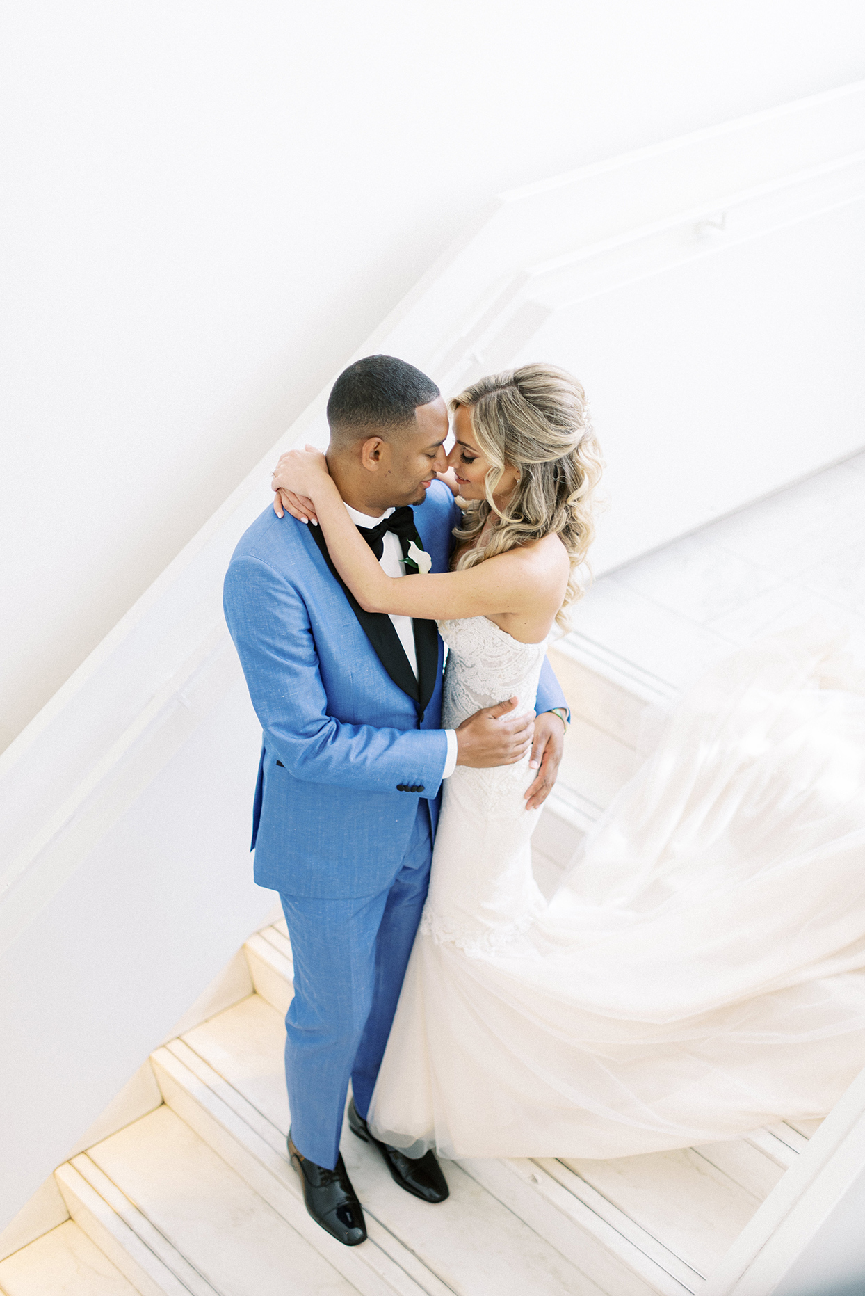 Bride and groom on stairs for first look