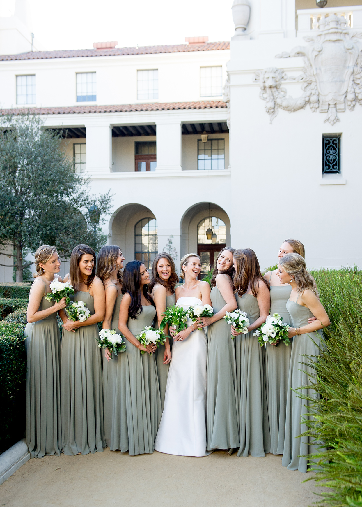 wedding bride and bridesmaids in pale green dresses