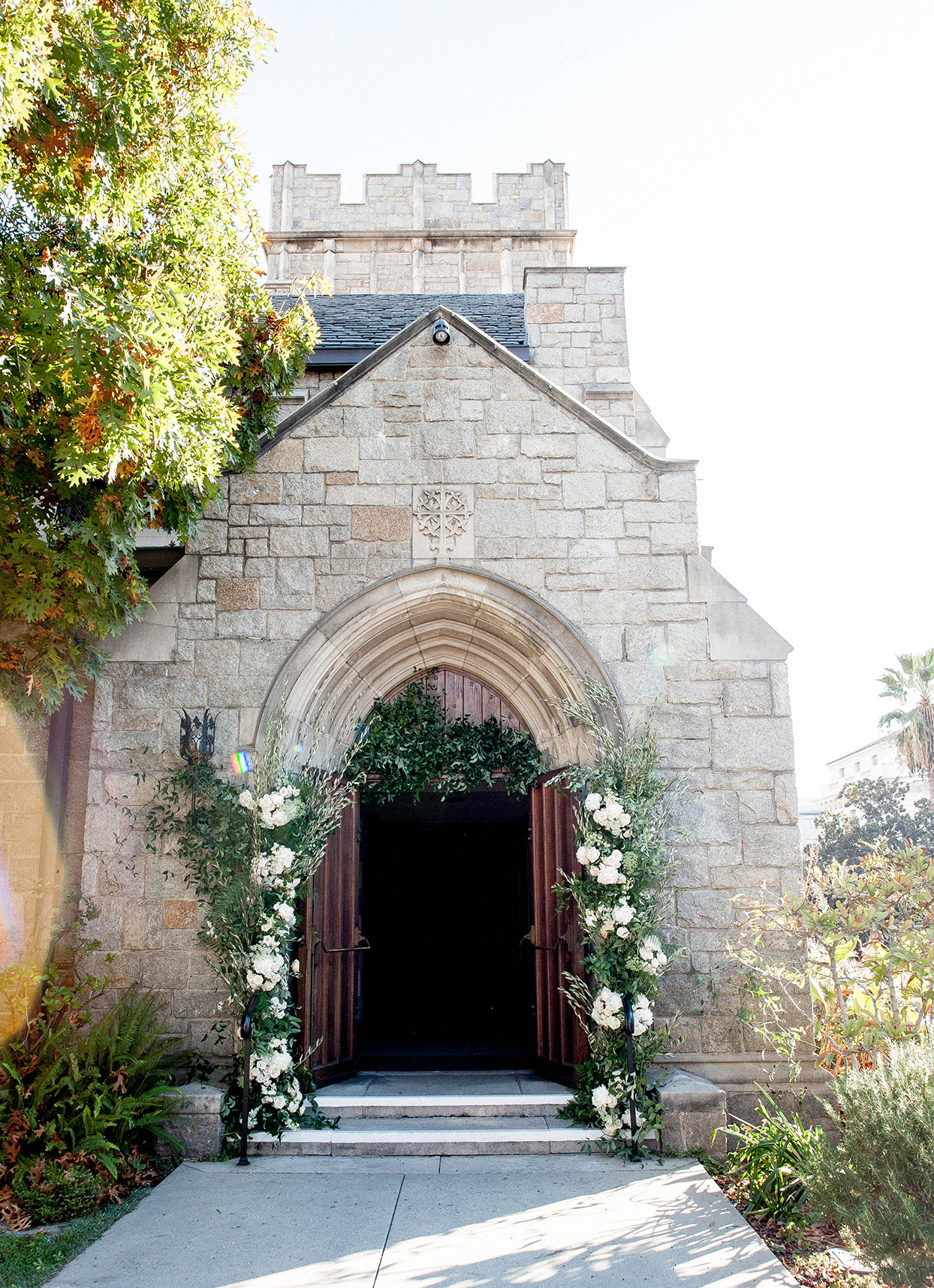 wedding church with open doors and floral arch