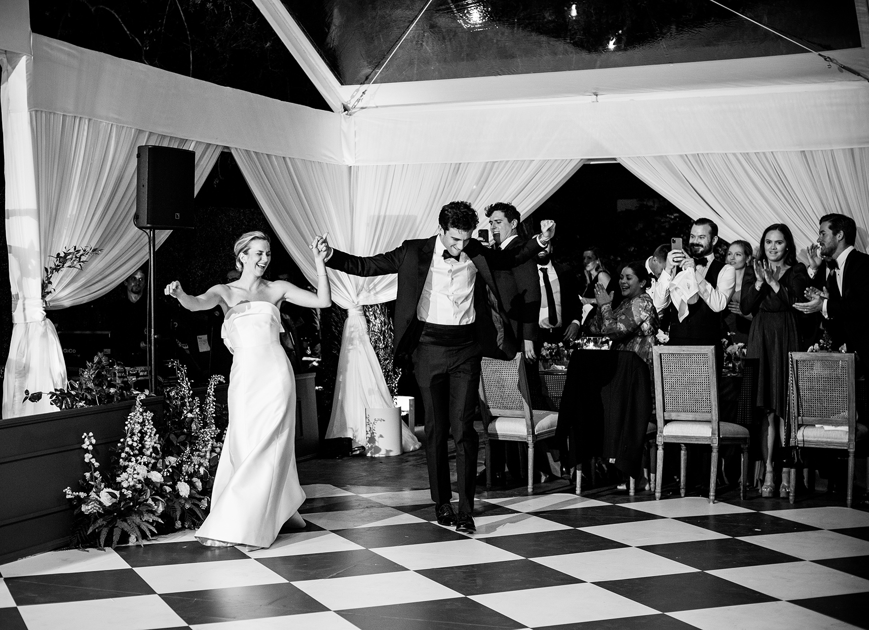 wedding couple dancing on checker dance floor