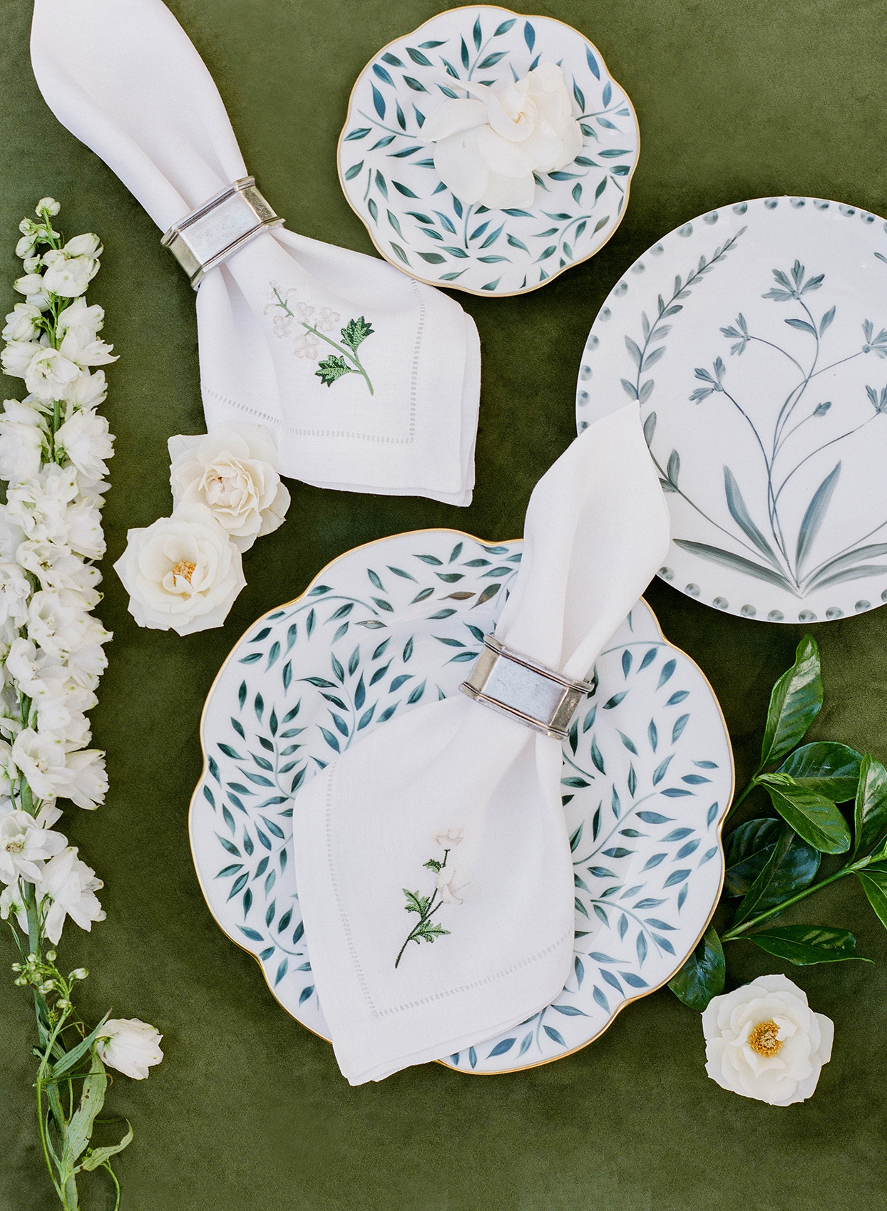 elegant white napkins on antique china plates