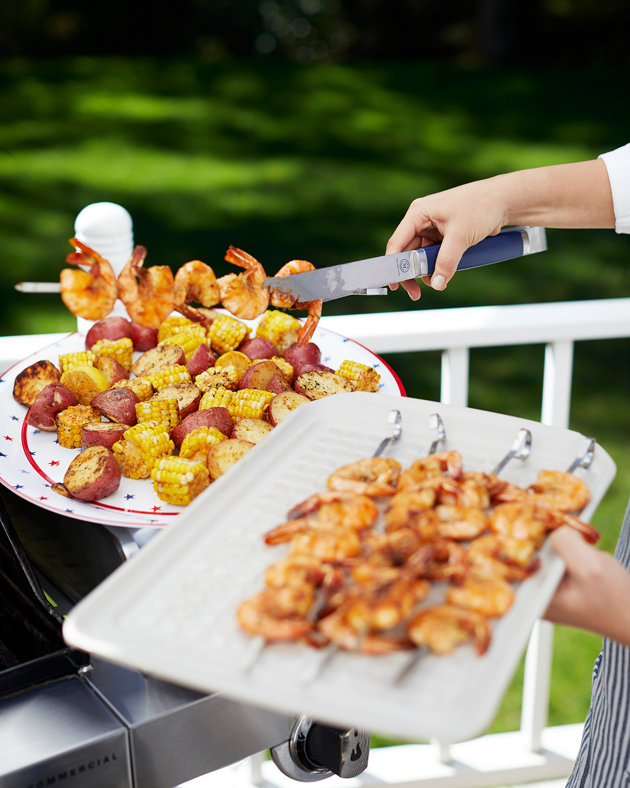 grilling shrimp and corn on trays