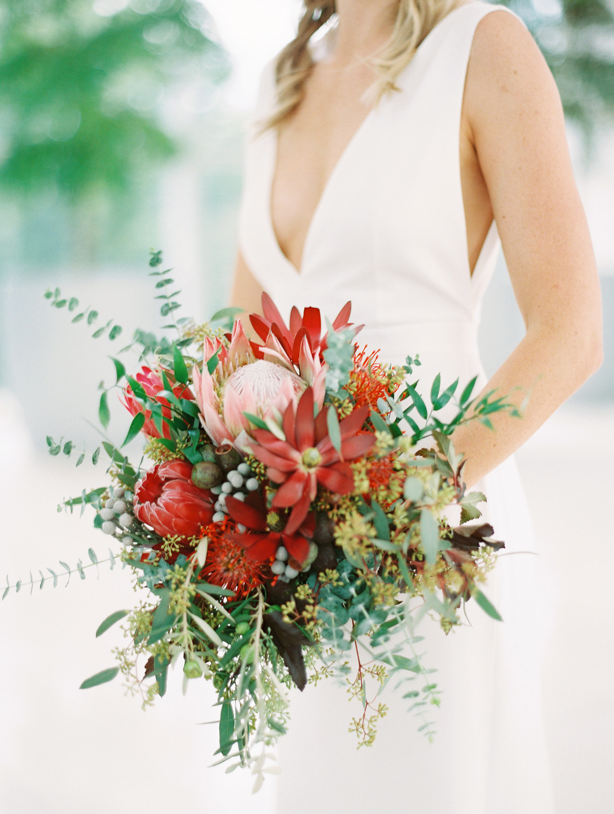 red and green floral wedding bouquet