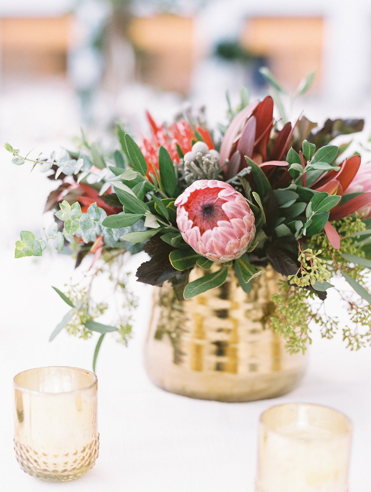 gold vase low green and red floral centerpieces