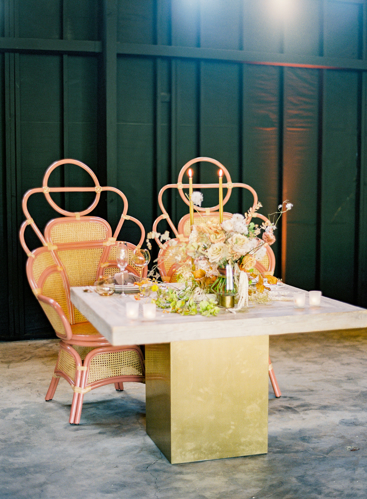 wedding reception sweetheart table with art deco style wicker chairs