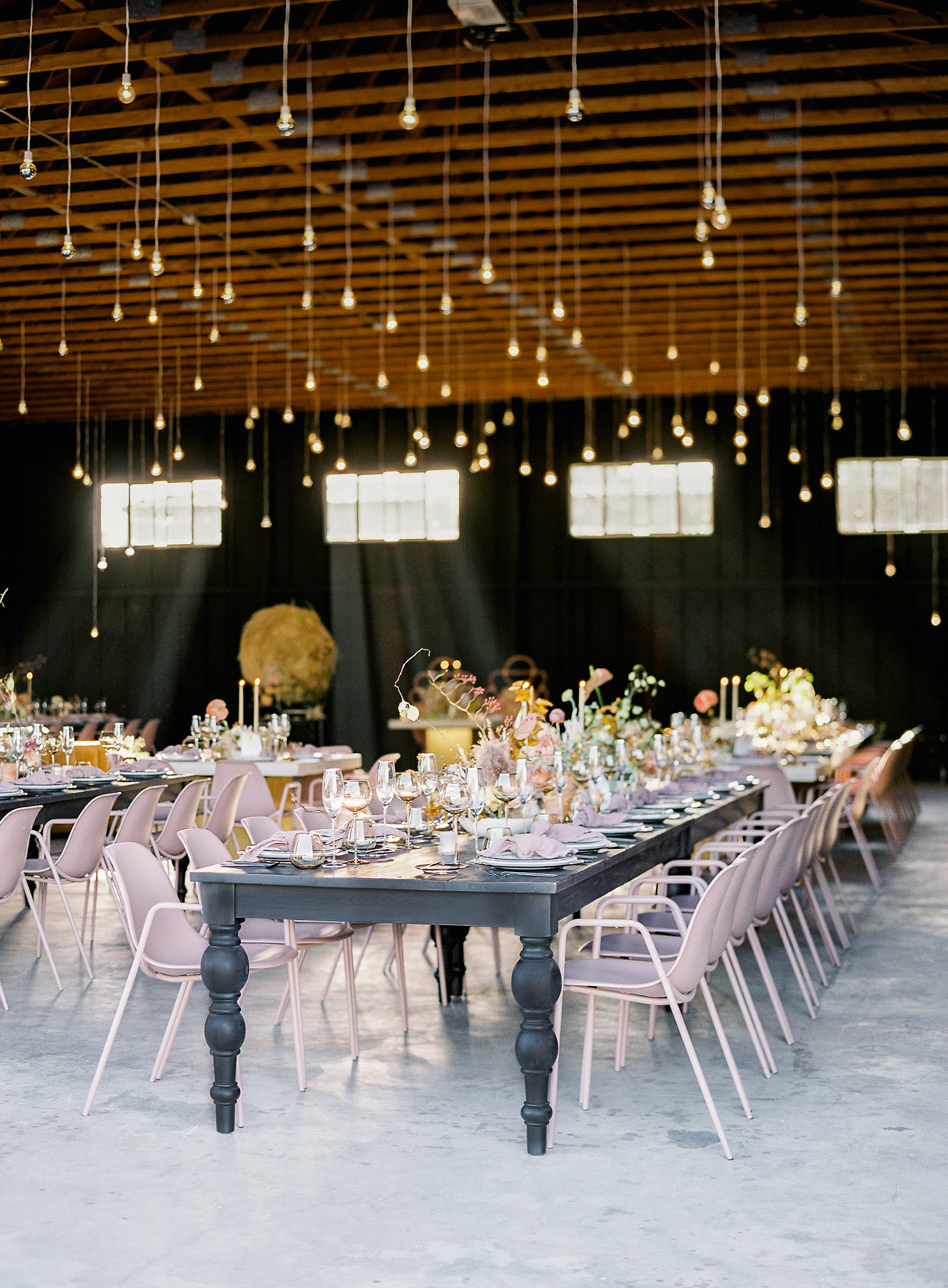 reception seating in barn with hanging bulbs installation