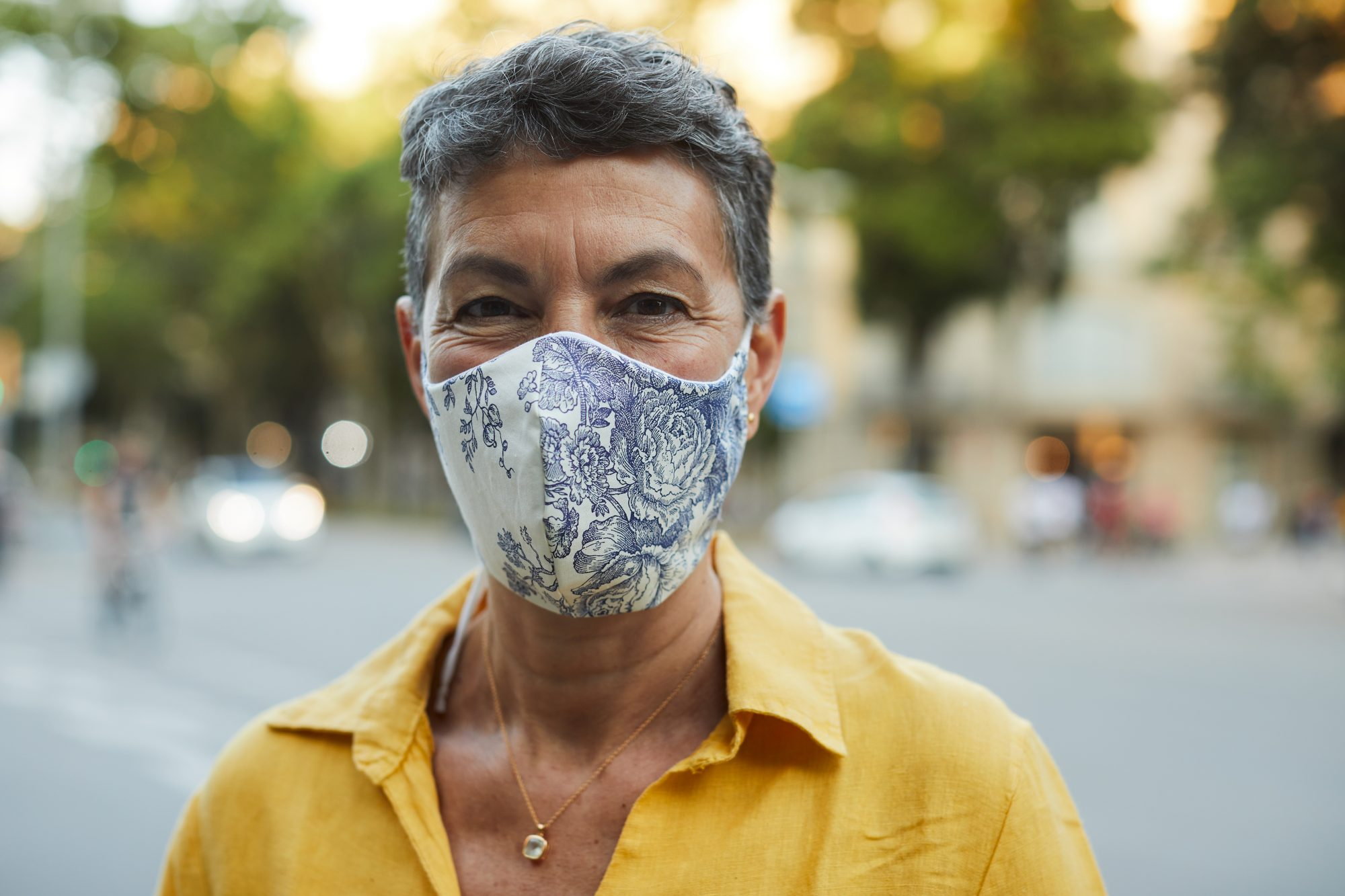 woman wearing blue and white face mask