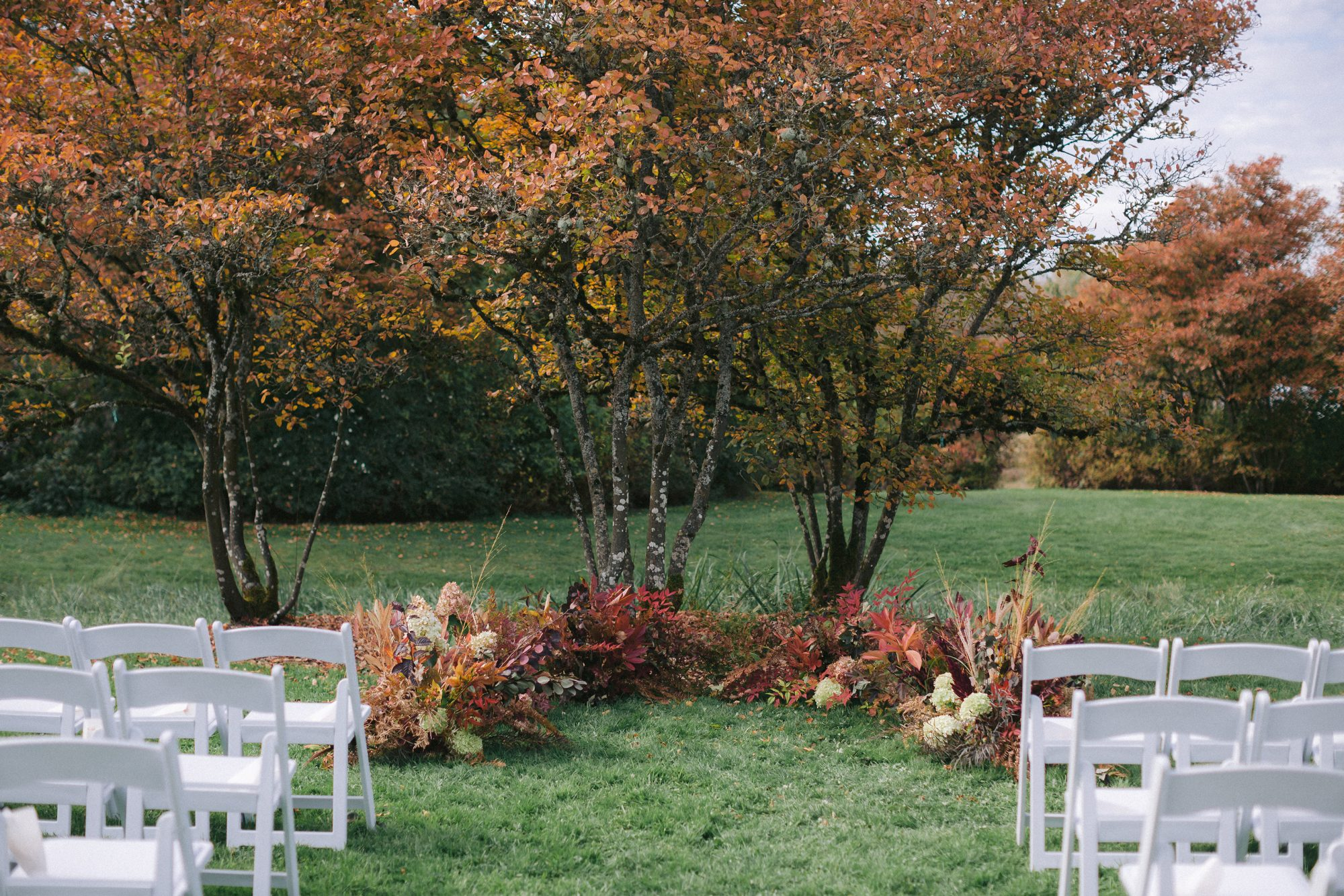 fall wedding ceremony space with grounded arch