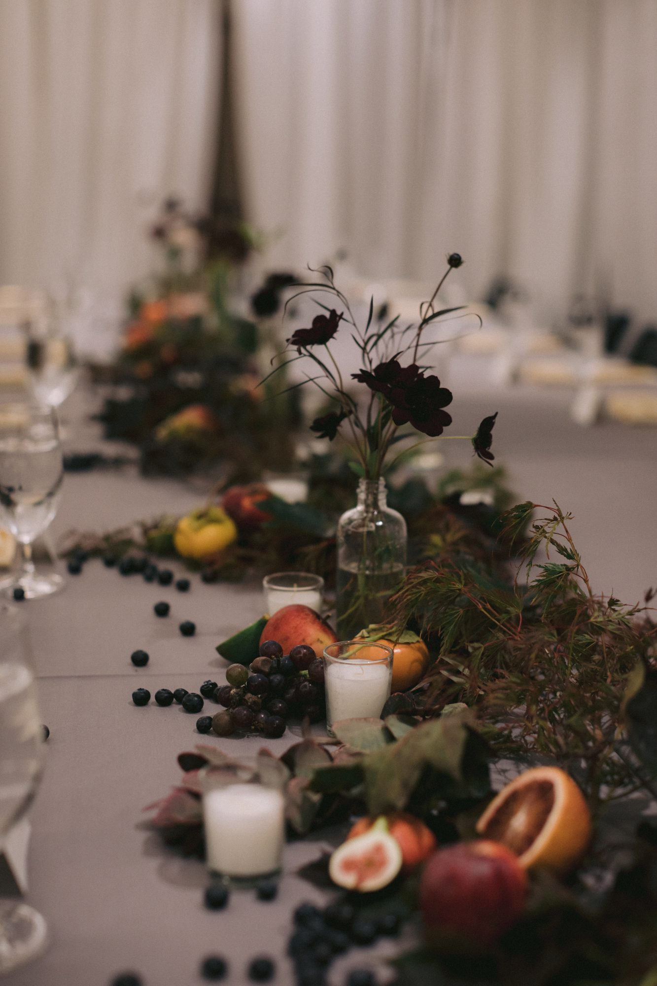 fruits and foliage running down wedding table