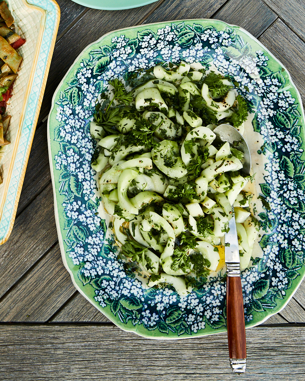 cucumber-herb salad served in floral-patterned dish
