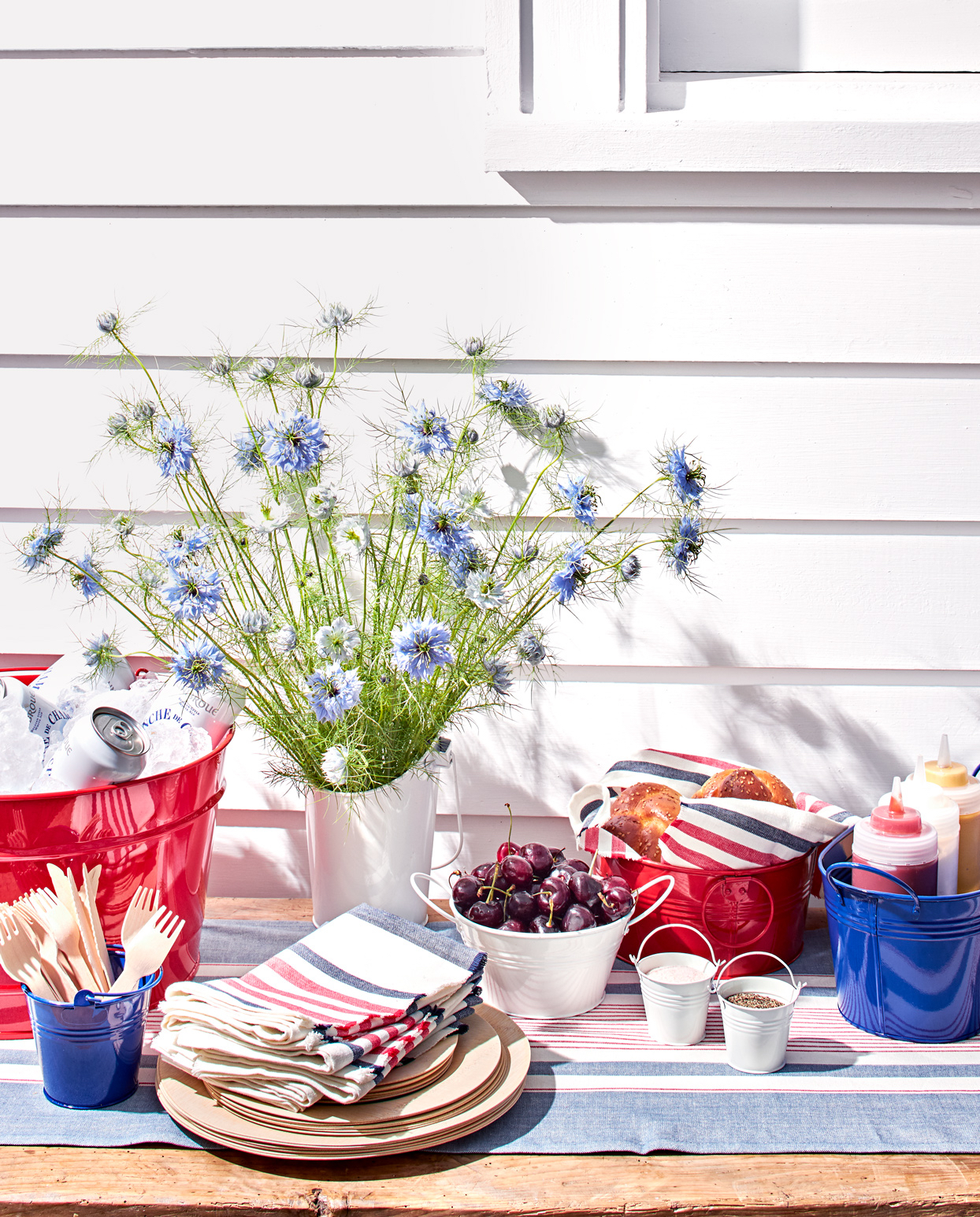 summer outdoor table with buckets in patriotic colors