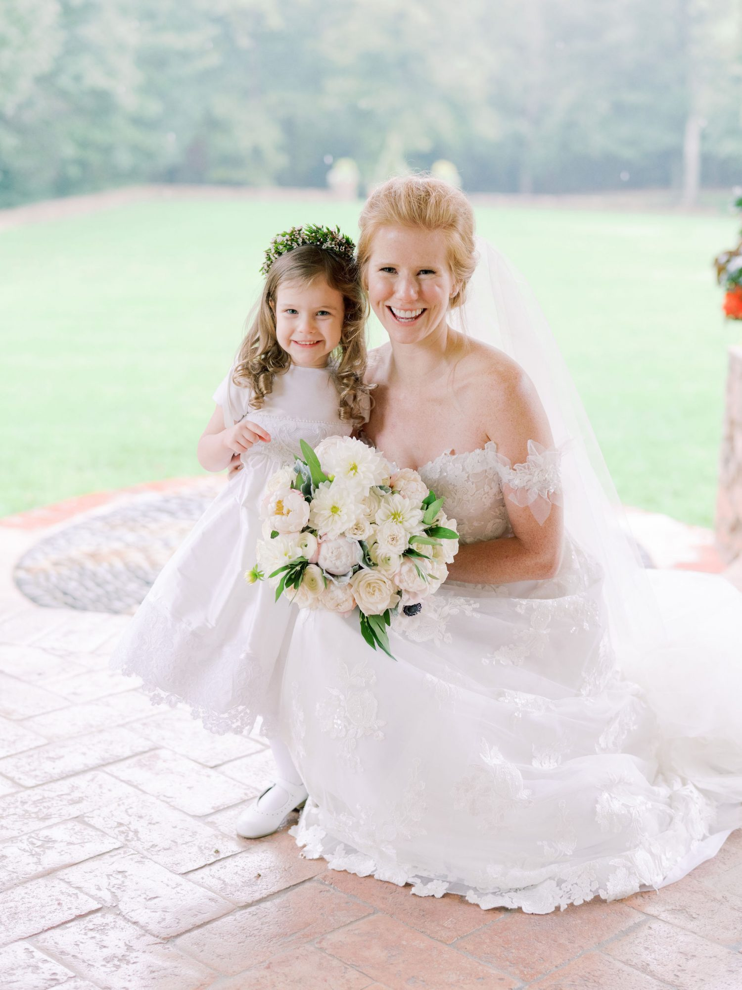 bride smiling with flower girl