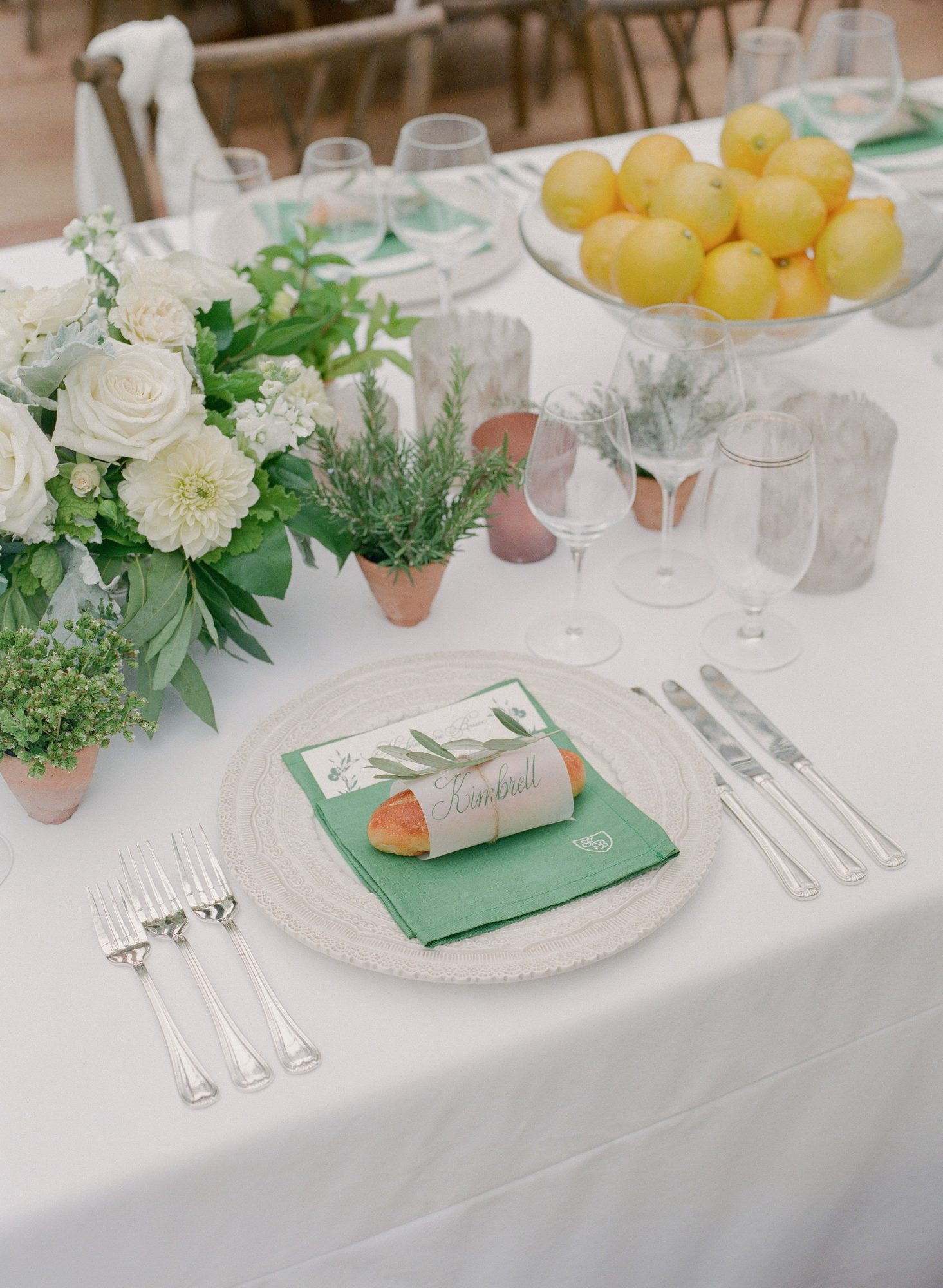 green napkin accented reception place settings