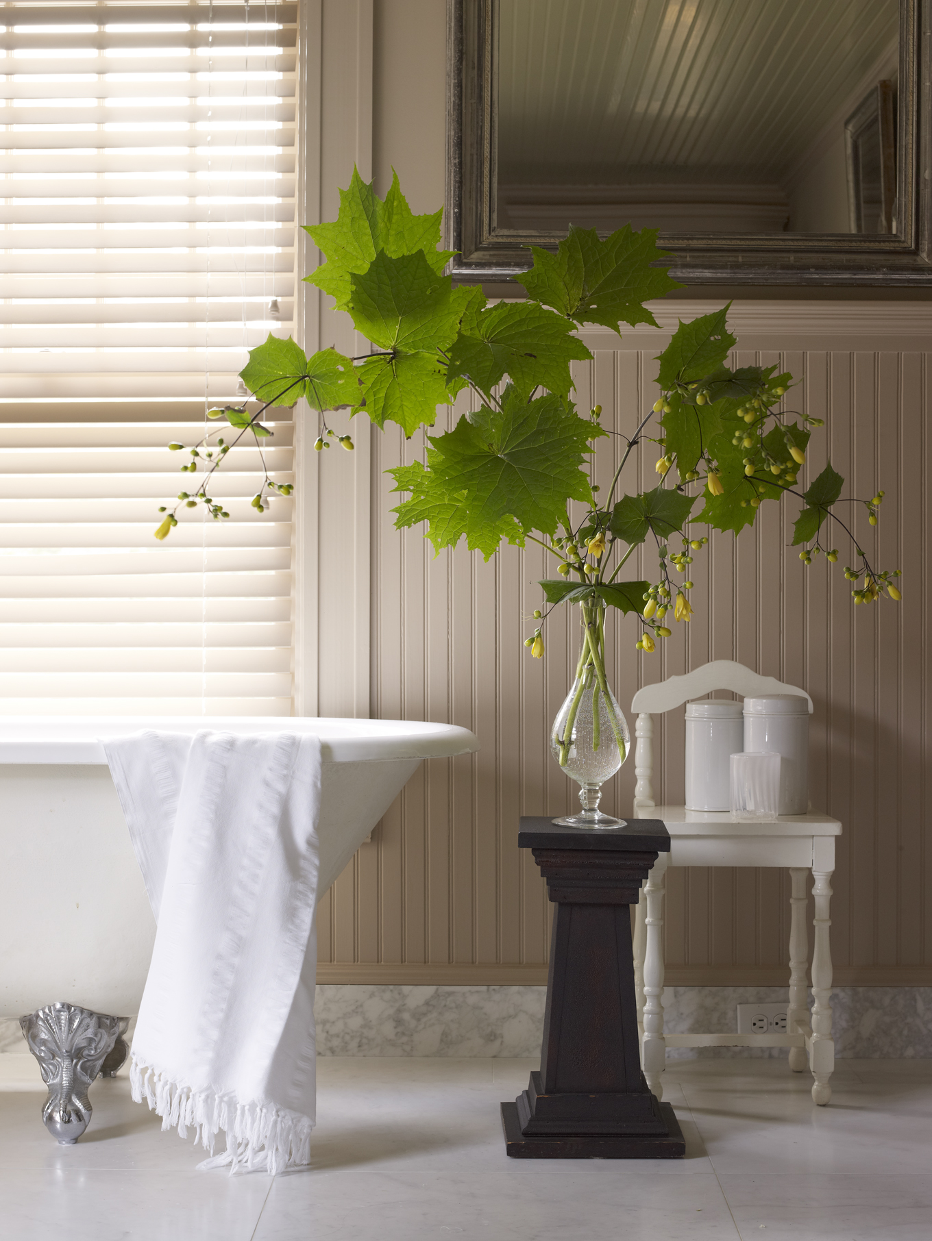 plant in glass vase in a bathroom