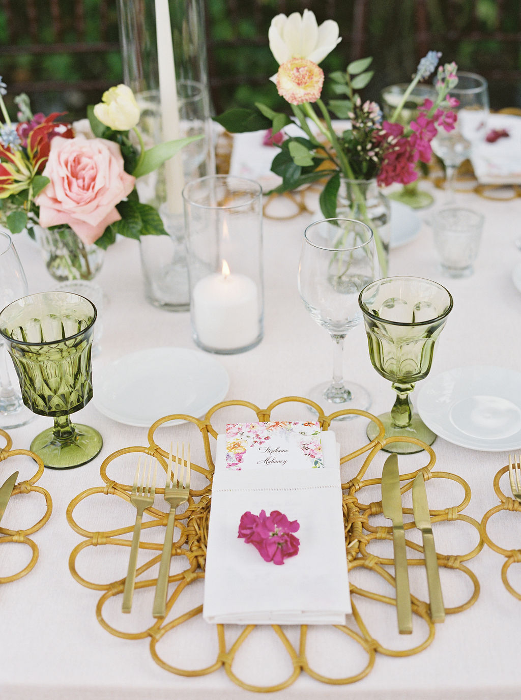 elegant wedding place setting with flower shaped charger and floral accents