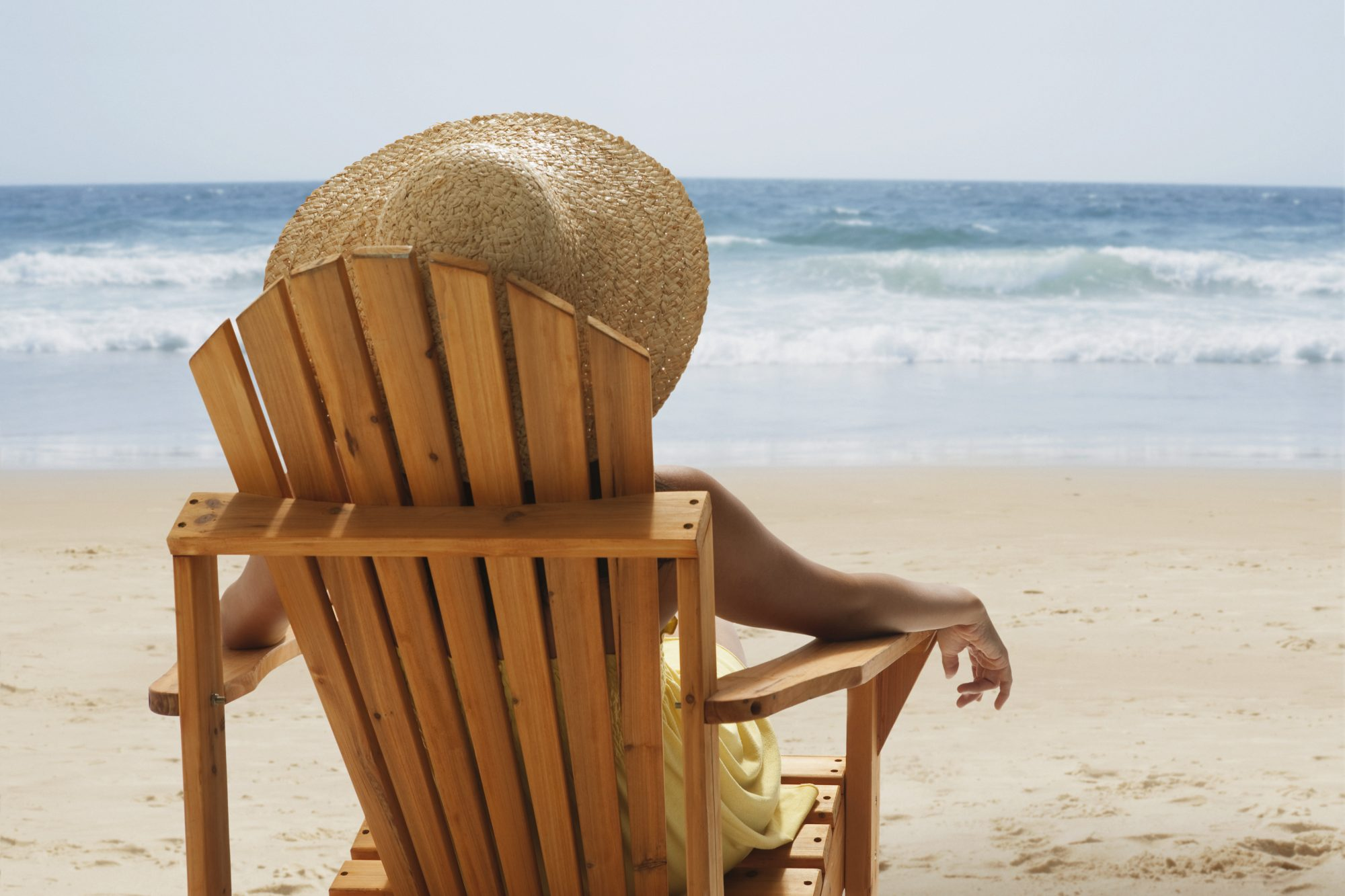 woman relaxing in chair on beach