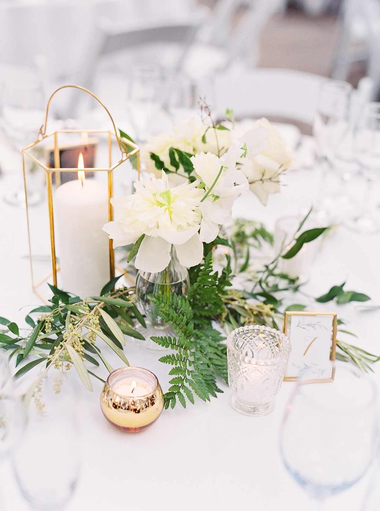 white elegant floral and candle wedding centerpieces