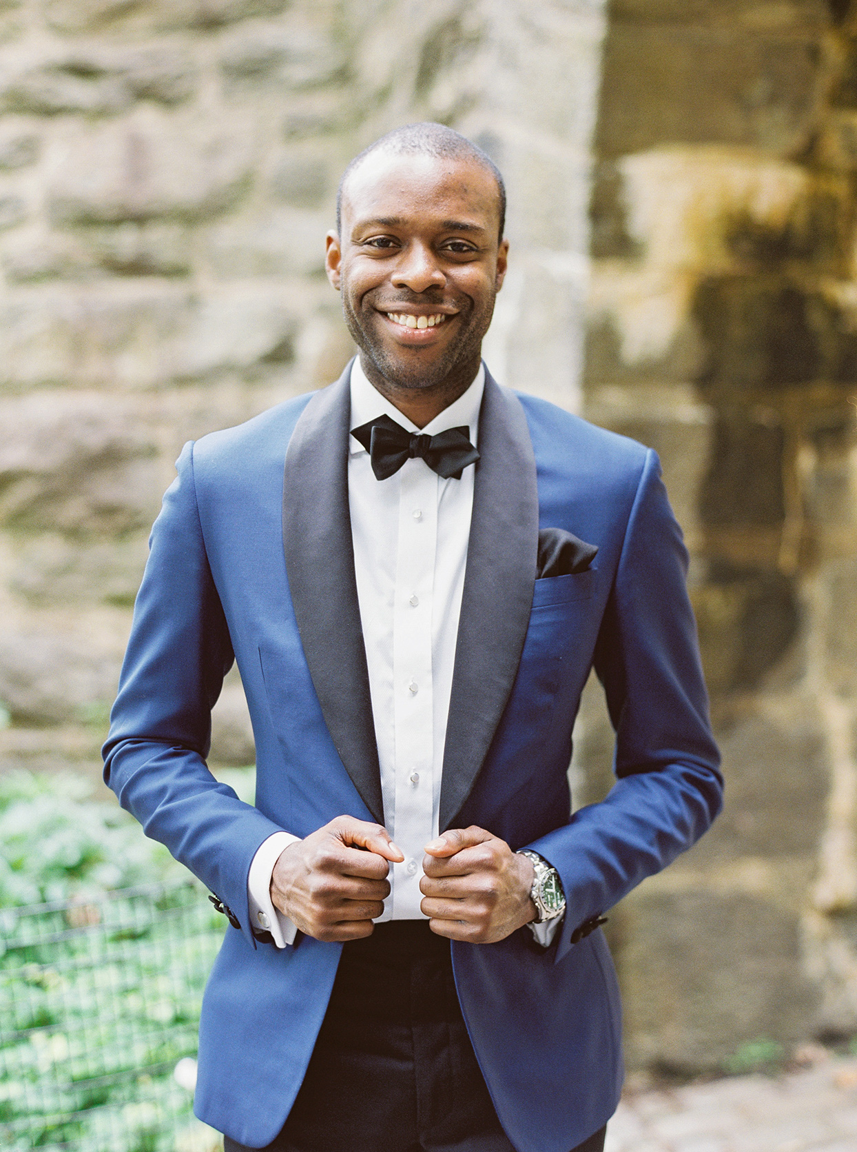 groom in blue and black tux