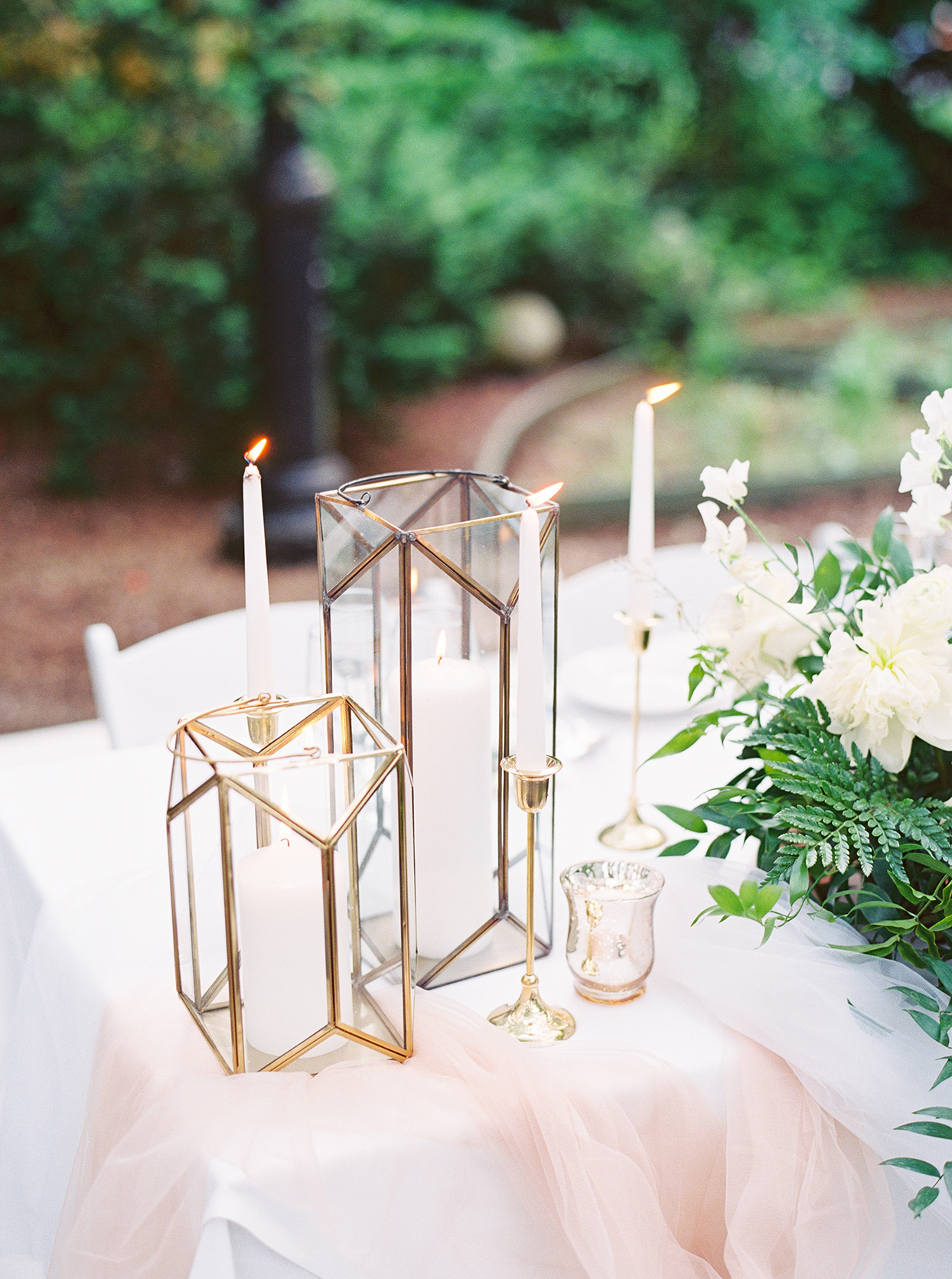 elegant white sweetheart table with candles