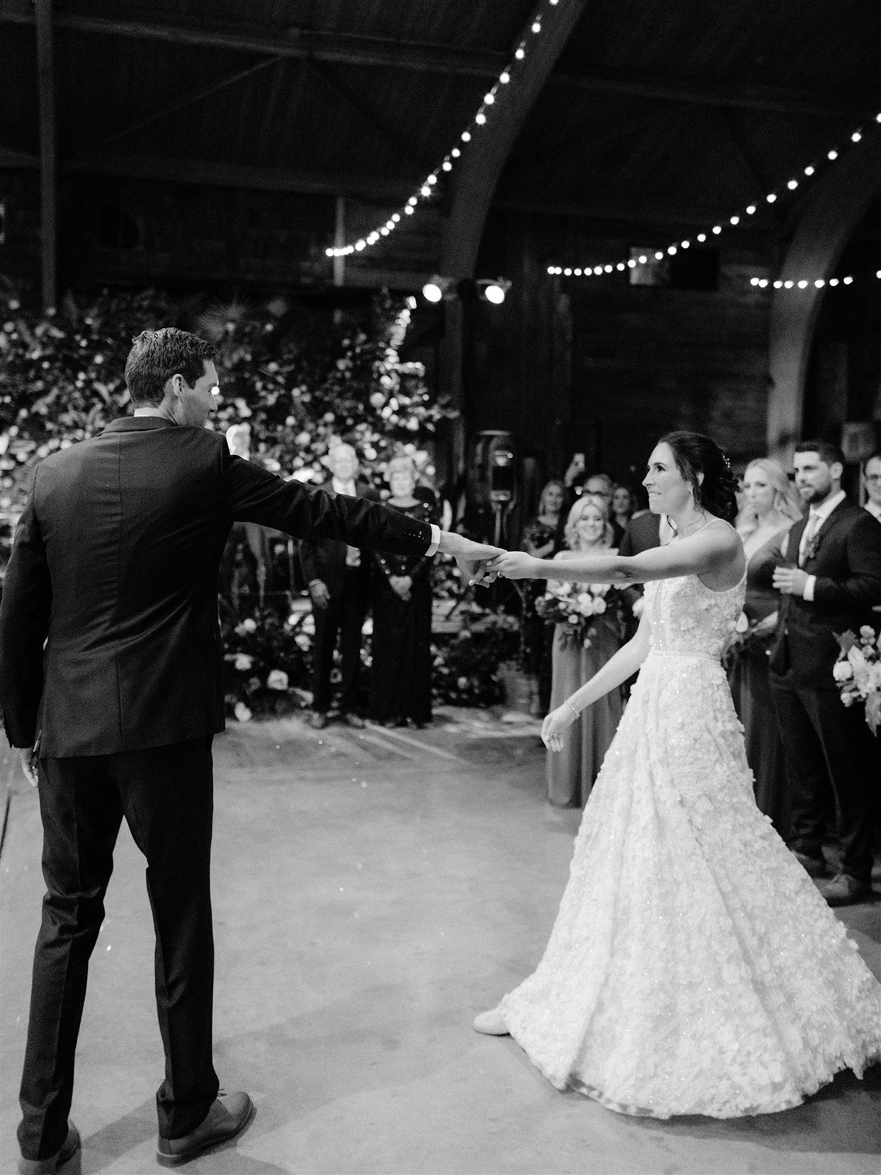 wedding couple spinning during first dance