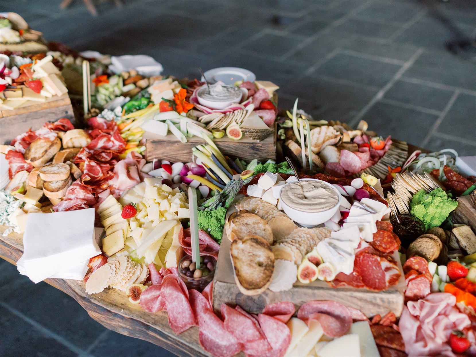 elaborate grazing table at wedding reception